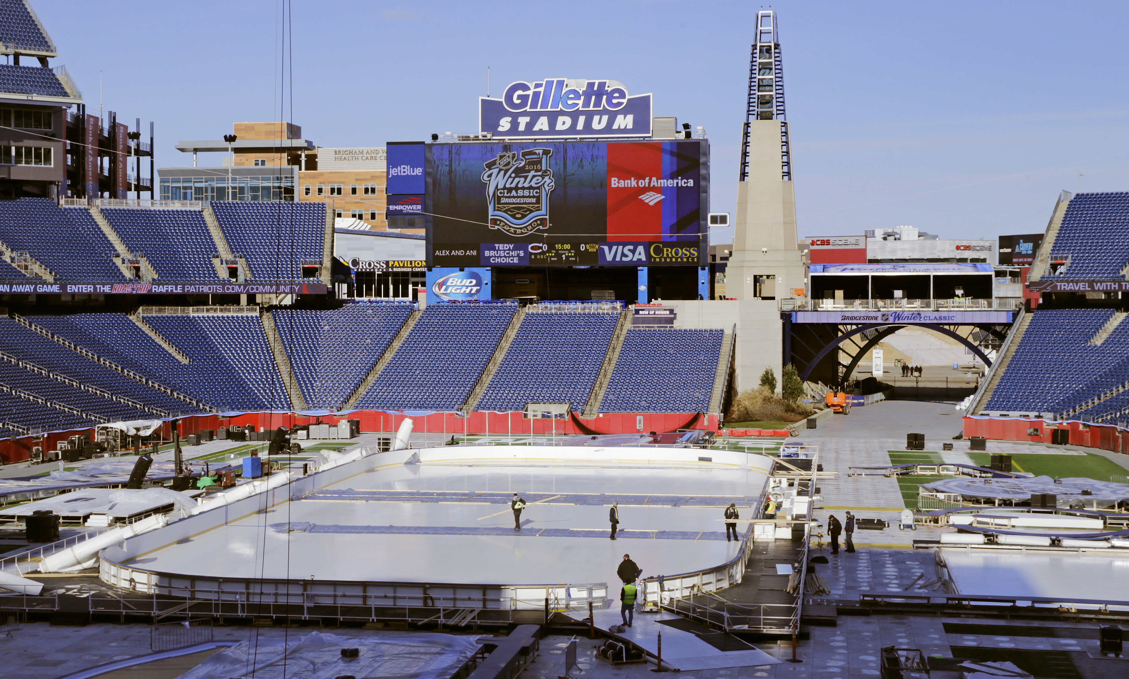 Workers prepare the Winter Classic hockey rink on the football field of Gillette Stadium in Foxborough, Mass., Monday, Dec. 28, 2015. The Montreal Canadiens face the Boston Bruins in the New Year's Day hockey game. Gillette Stadium is the home of the New