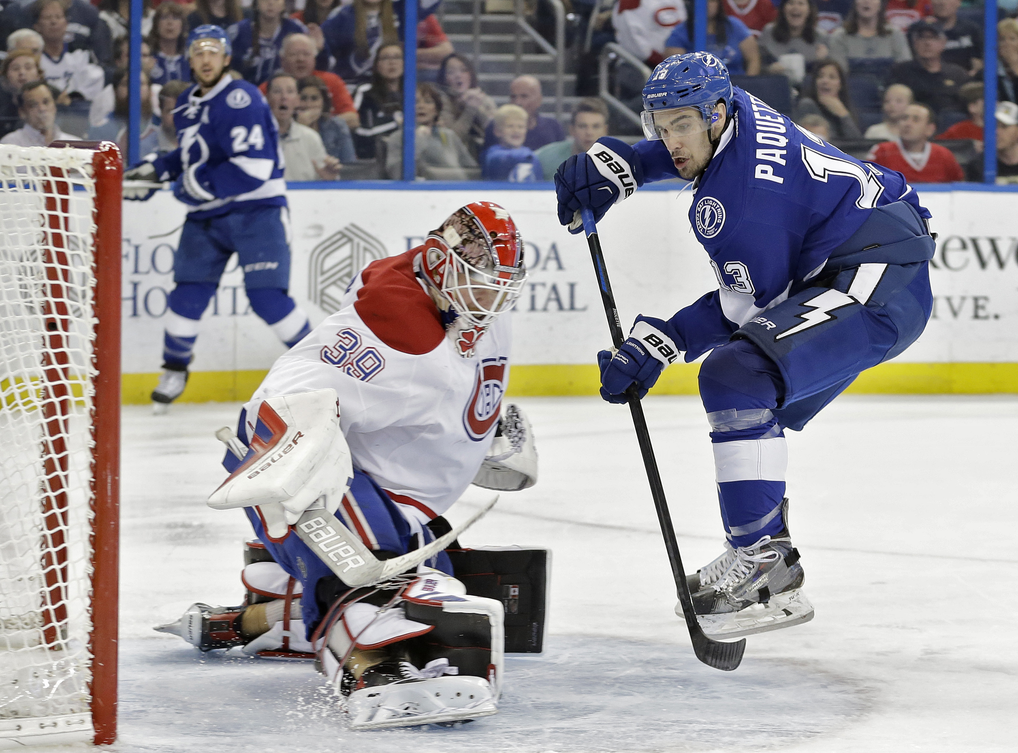 Tampa Bay Lightning center Cedric Paquette (13) watches his shot get stopped by Montreal Canadiens goalie Mike Condon (39) during the second period of an NHL hockey game Monday, Dec. 28, 2015, in Tampa, Fla. (AP Photo/Chris O'Meara)