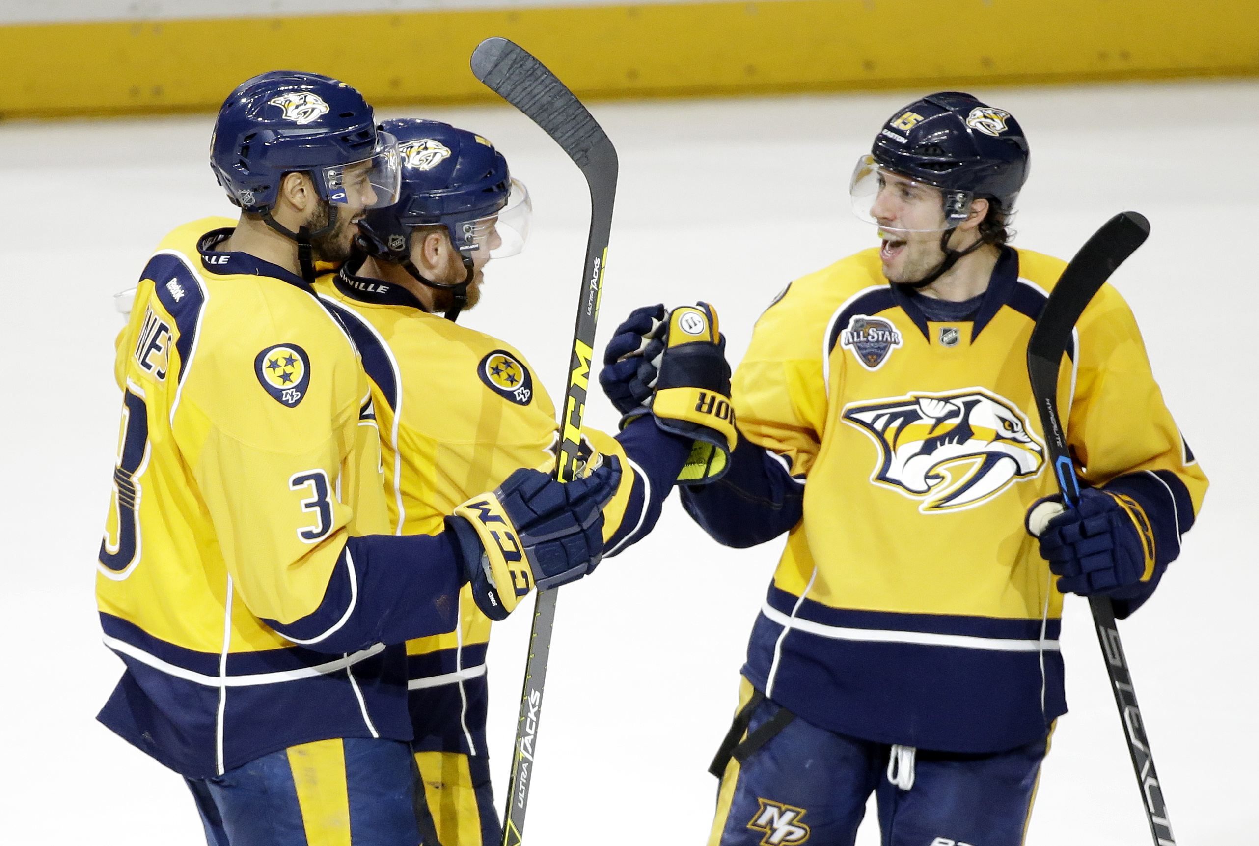 Nashville Predators defenseman Ryan Ellis, center, is congratulated by Seth Jones (3) and James Neal (18) after Ellis scored a goal against the New York Rangers in the third period of an NHL hockey game Monday, Dec. 28, 2015, in Nashville, Tenn. (AP Photo
