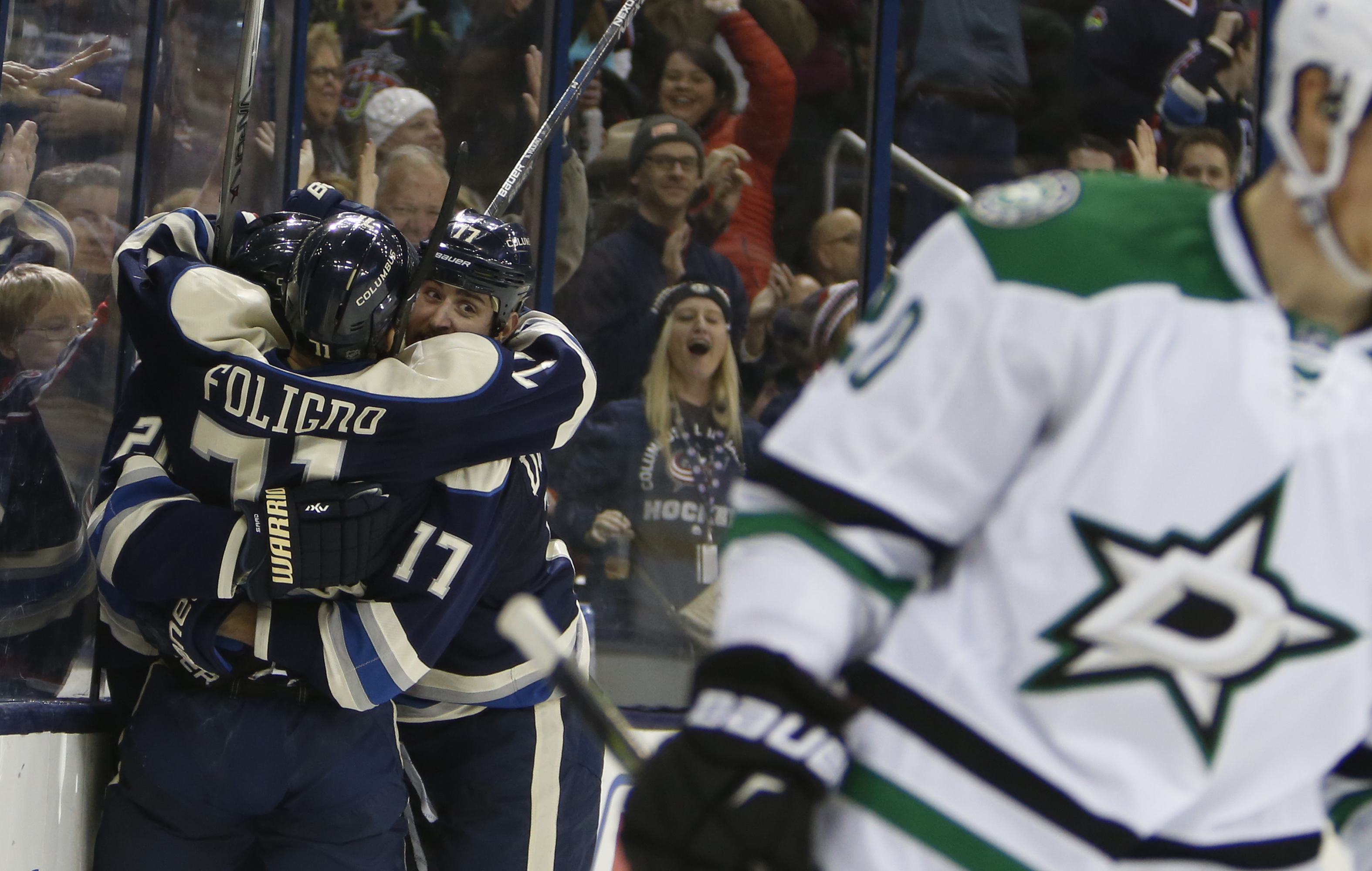 Columbus Blue Jackets' Brandon Saad, left to right, Nick Foligno and Brandon Dubinsky celebrate their goal against the Dallas Stars during the second period of an NHL hockey game Tuesday, Dec. 29, 2015, in Columbus, Ohio. The Blue Jackets won 6-3. (AP Pho