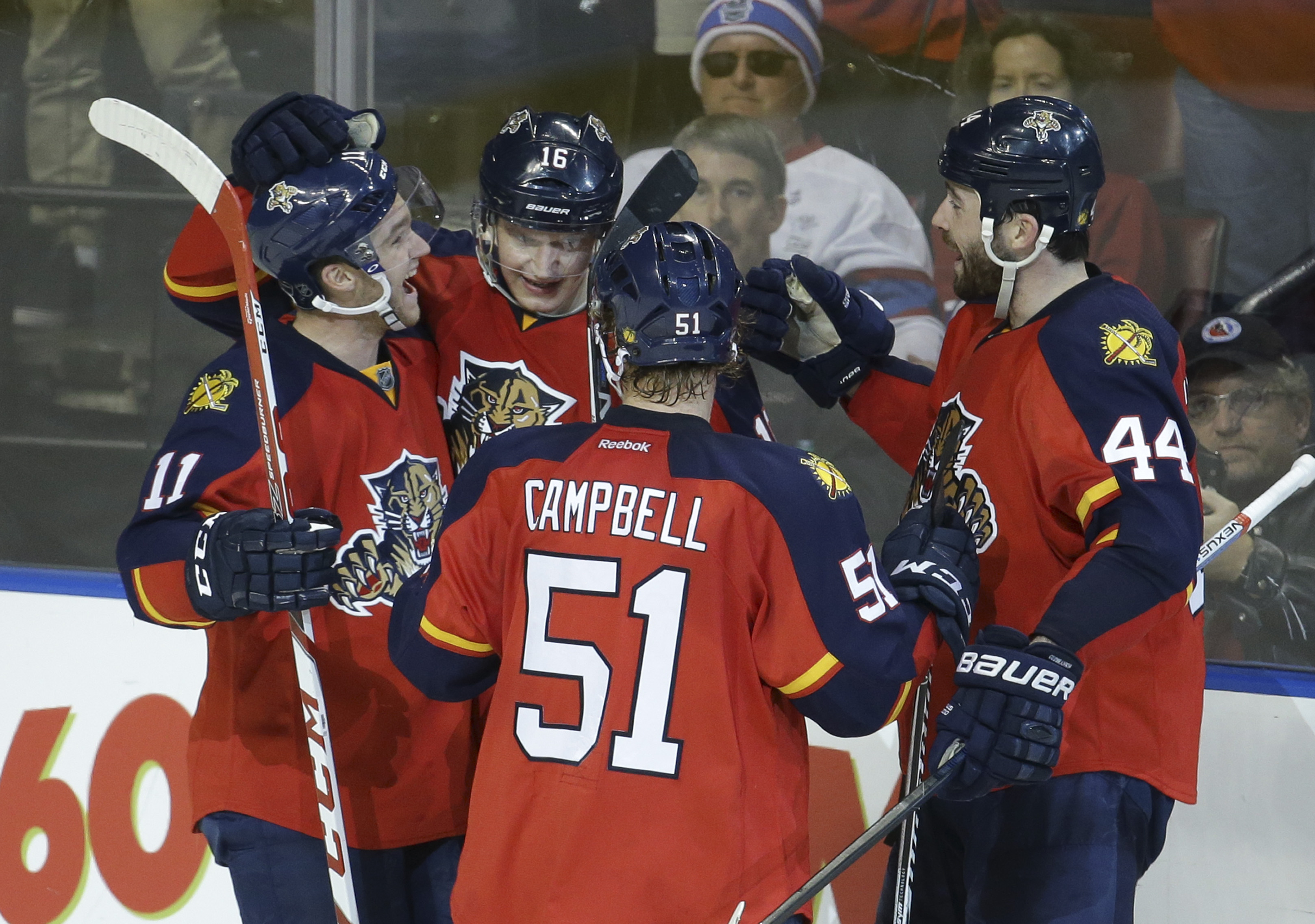 Florida Panthers center Aleksander Barkov (16) is congratulated by center Jonathan Huberdeau (11), defenseman Brian Campbell (51) and defenseman Erik Gudbranson (44) after scoring a goal during the third period of an NHL hockey game against the Montreal C