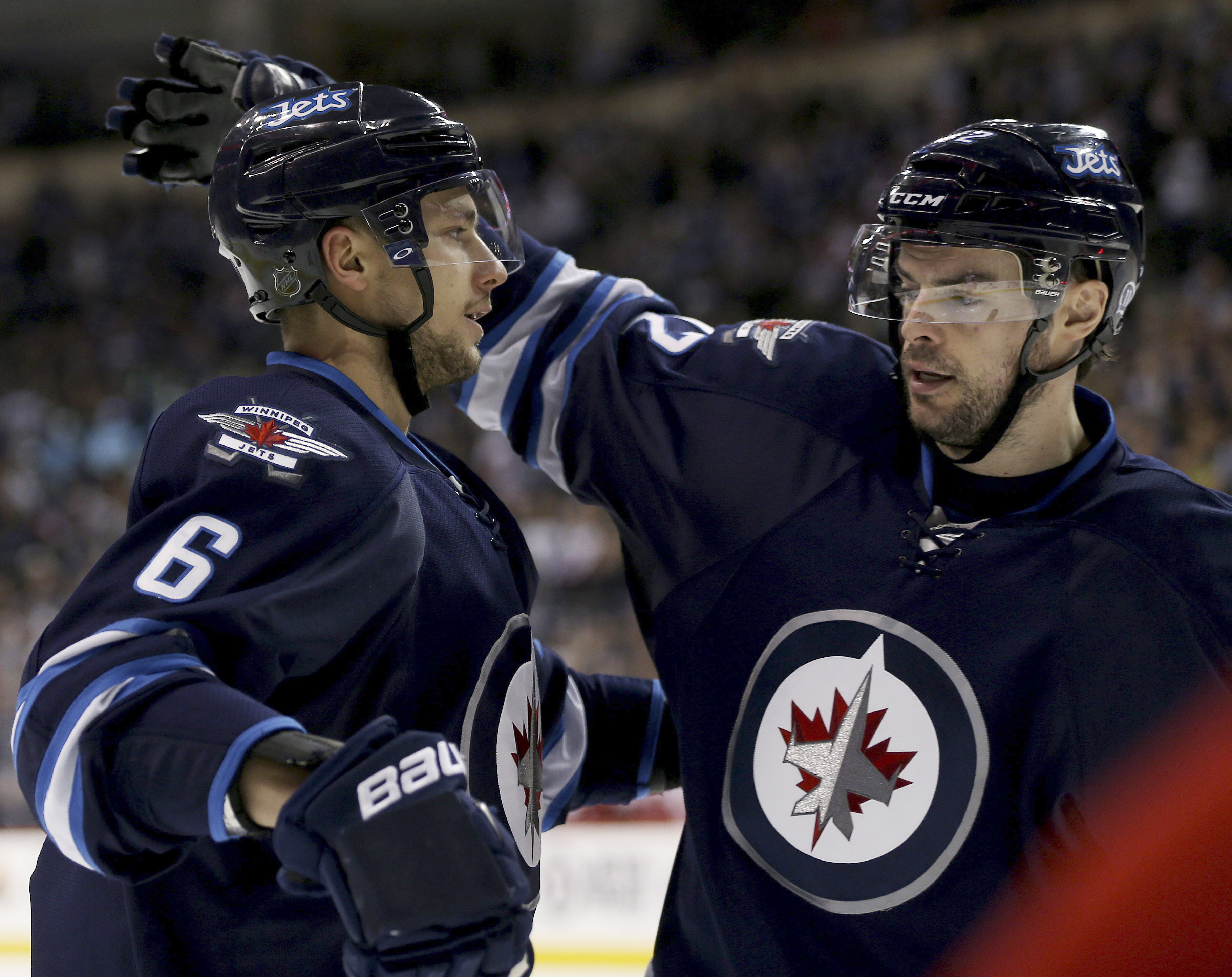 Winnipeg Jets' Alexander Burmistrov (6) and Drew Stafford (12) celebrate after Burmistrov scored against the Detroit Red Wings during the second period of an NHL hockey game Tuesday, Dec. 29, 2015, in Winnipeg, Manitoba. (Trevor Hagan/The Canadian Press v