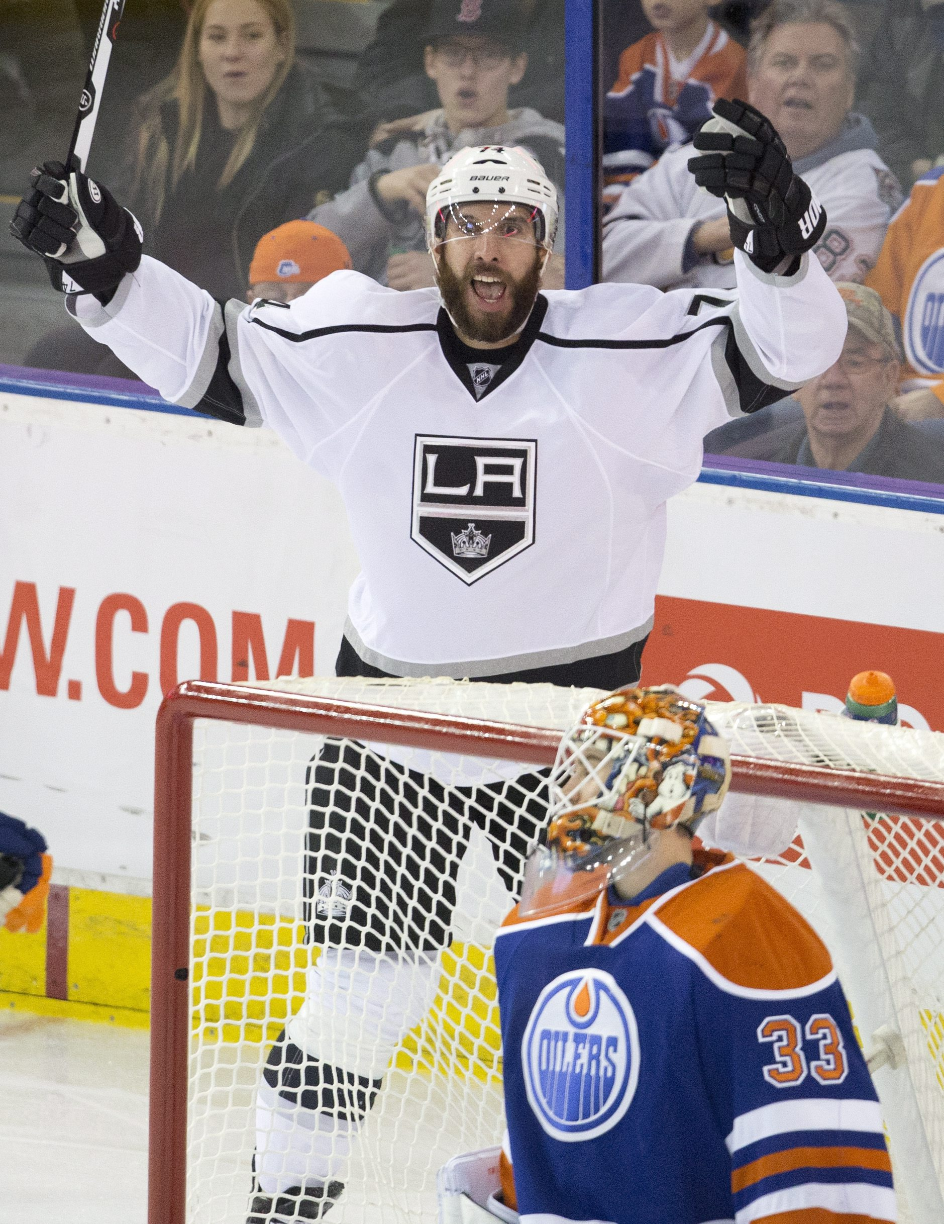 Los Angeles Kings' Dwight King (74) celebrates a goal against Edmonton Oilers' goalie Cam Talbot (33) during the second period of an NHL hockey game in Edmonton, Alberta, Tuesday, Dec. 29, 2015. (Janson Franson/The Canadian Press via AP) MANDATORY CREDIT