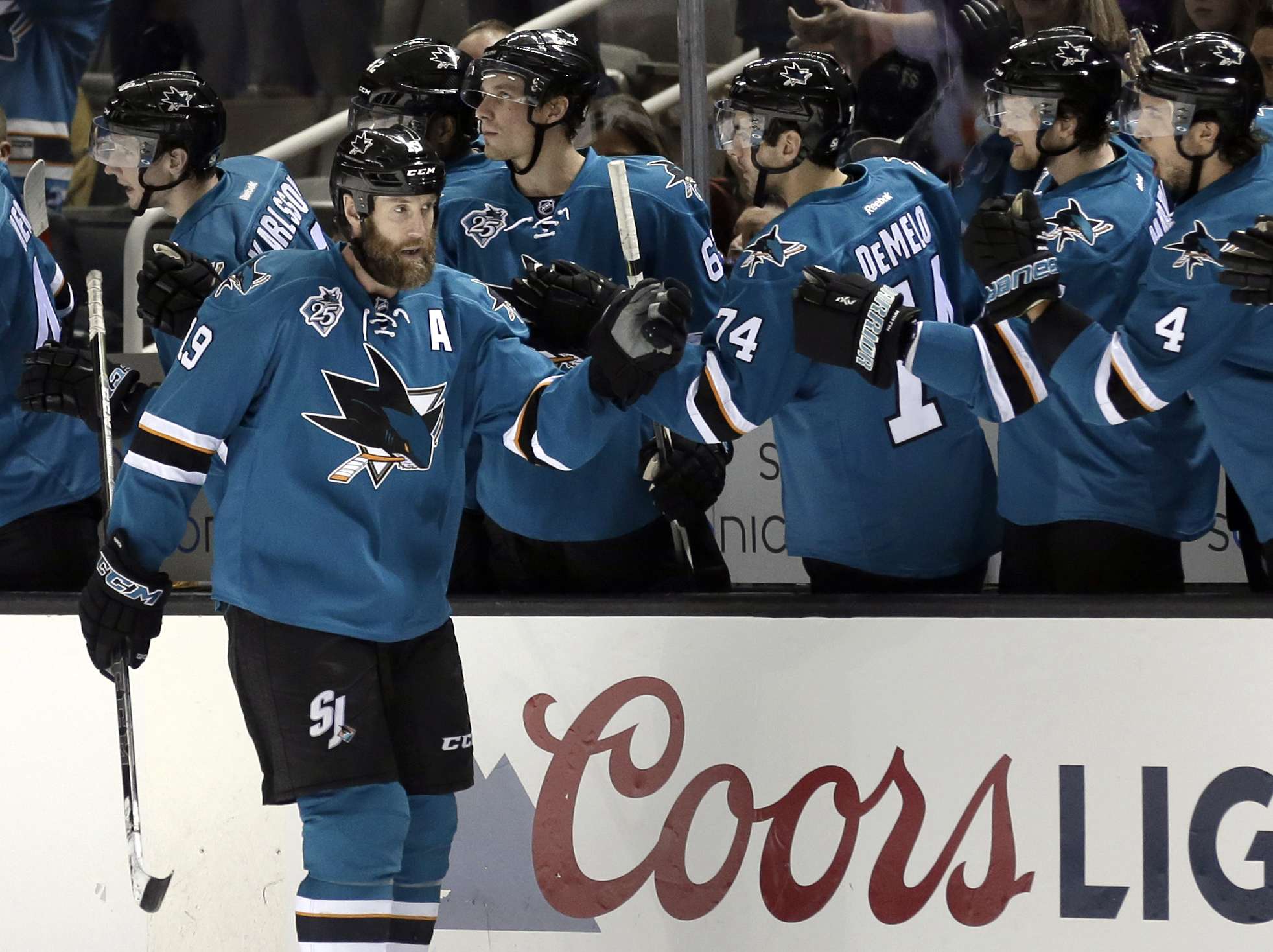 San Jose Sharks' Joe Thornton, left, is congratulated after scoring against the Philadelphia Flyers during the second period of an NHL hockey game Wednesday, Dec. 30, 2015, in San Jose, Calif. (AP Photo/Ben Margot)