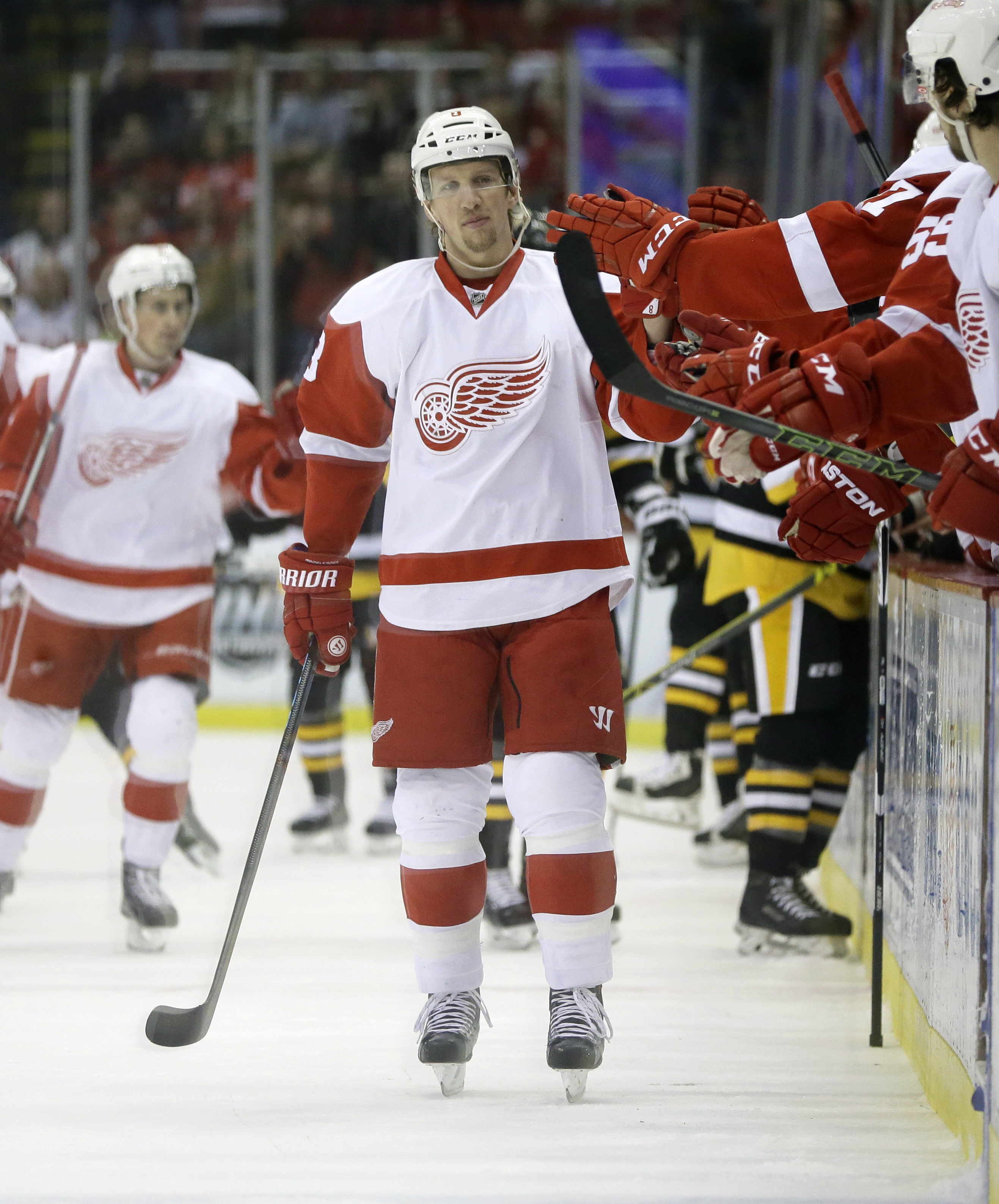 Detroit Red Wings left wing Justin Abdelkader is congratulated by teammates after scoring during the first period of an NHL hockey game against the Pittsburgh Penguins, Thursday, Dec. 31, 2015, in Detroit. (AP Photo/Carlos Osorio)