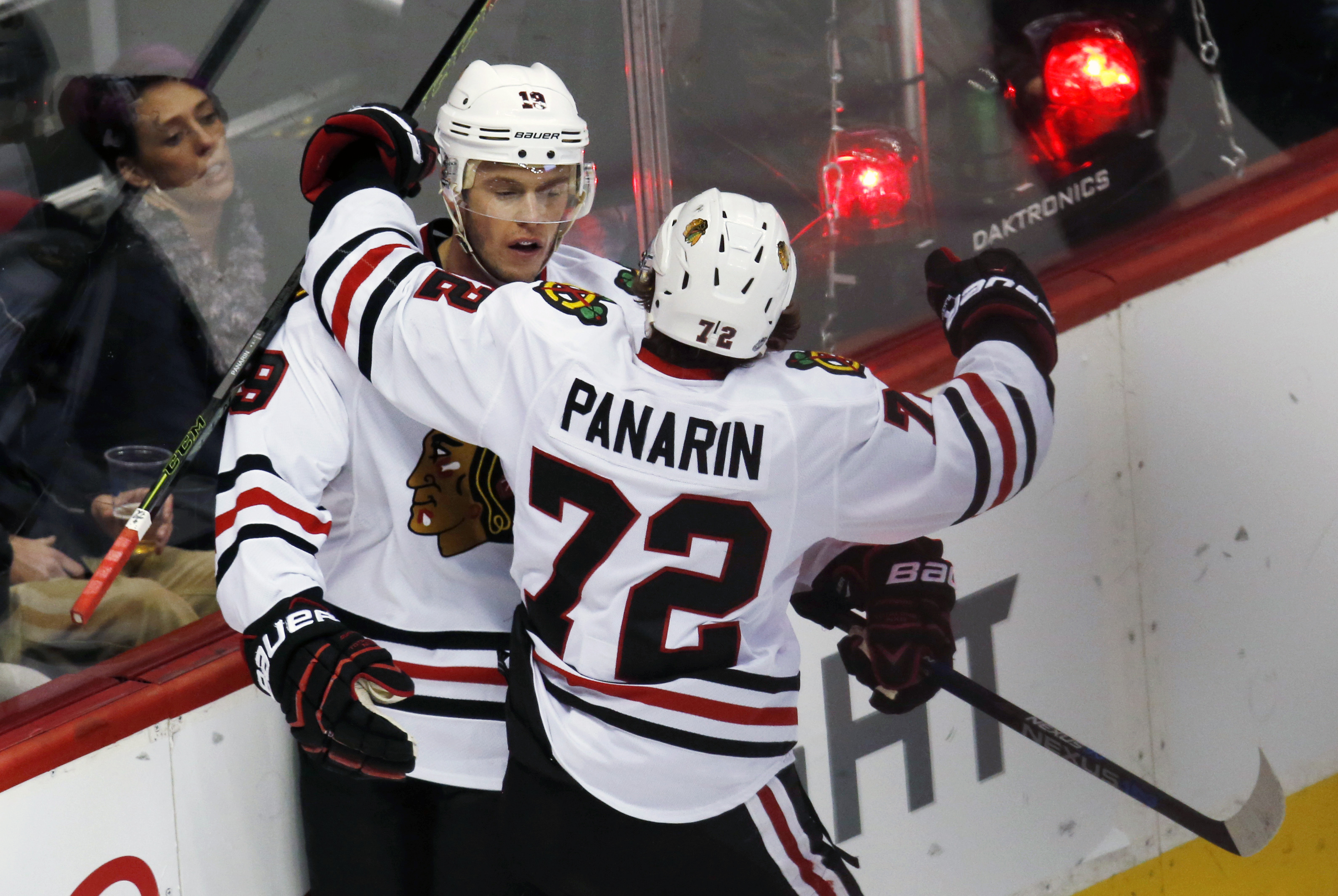 Chicago Blackhawks center Jonathan Toews, left, celebrates after scoring the winning goal with left wing Artemi Panarin, of Russia, against the Colorado Avalanche in overtime of an NHL hockey game Thursday, Dec. 31, 2015, in Denver. Chicago won 4-3. (AP P
