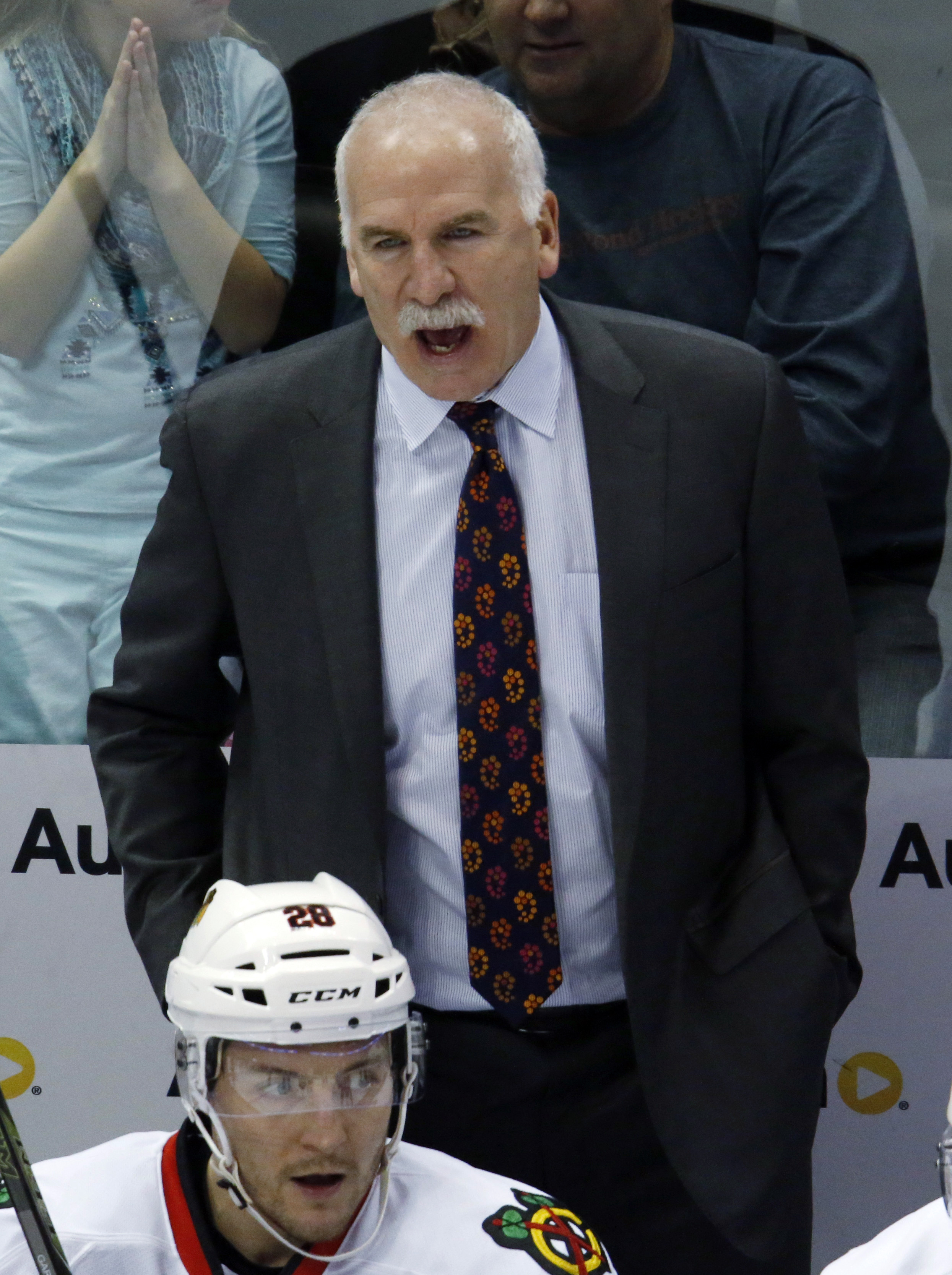Chicago Blackhawks head coach Joel Quenneville, top, directs his team against the Colorado Avalanche in third period of an NHL hockey game Thursday, Dec. 31, 2015, in Denver. Chicago won 4-3 in overtime. (AP Photo/David Zalubowski)