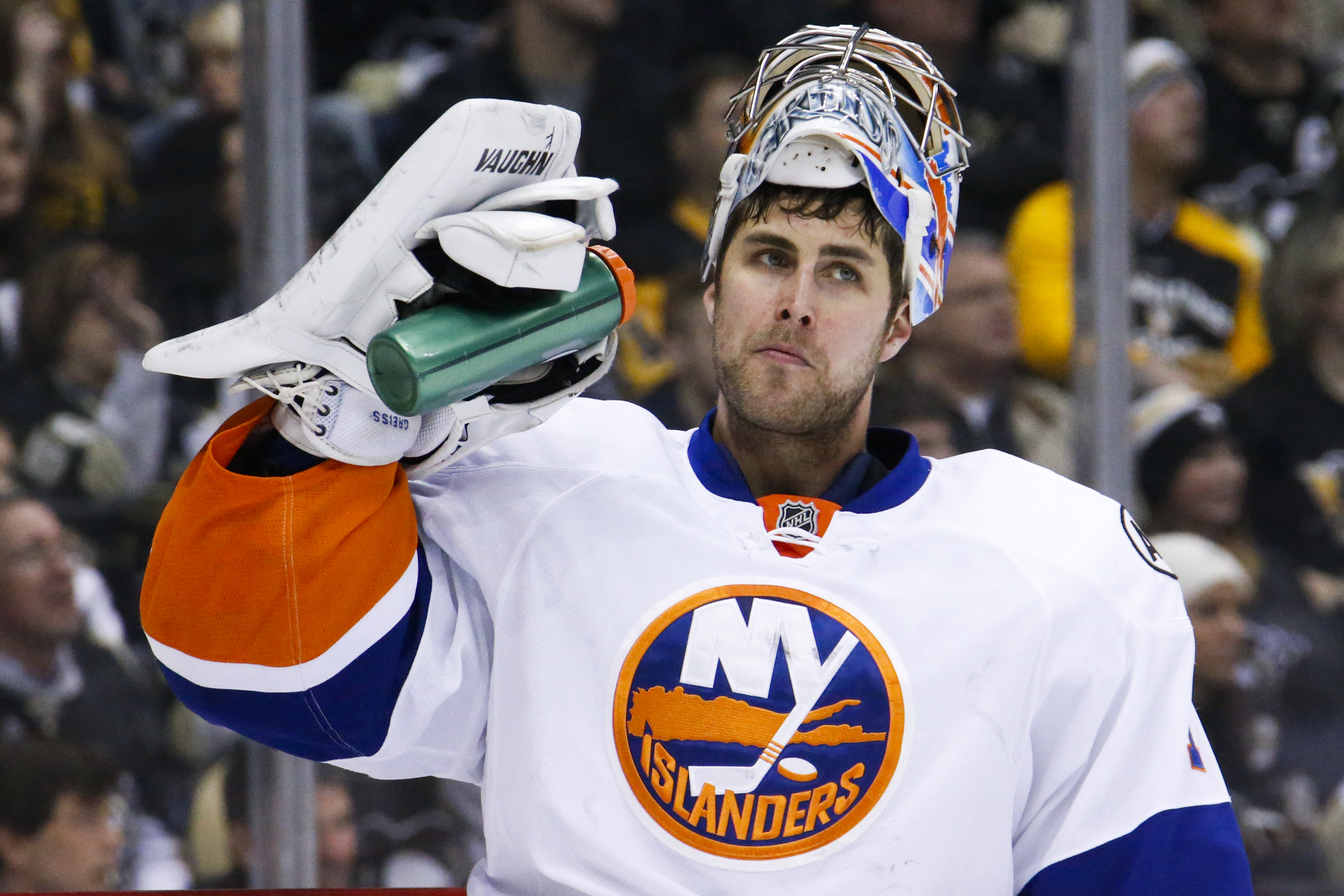 New York Islanders goalie Thomas Greiss takes a drink after giving up a goal to Pittsburgh Penguins' Sidney Crosby during the second period of an NHL hockey game in Pittsburgh, Saturday, Jan. 2, 2016. (AP Photo/Gene J. Puskar)