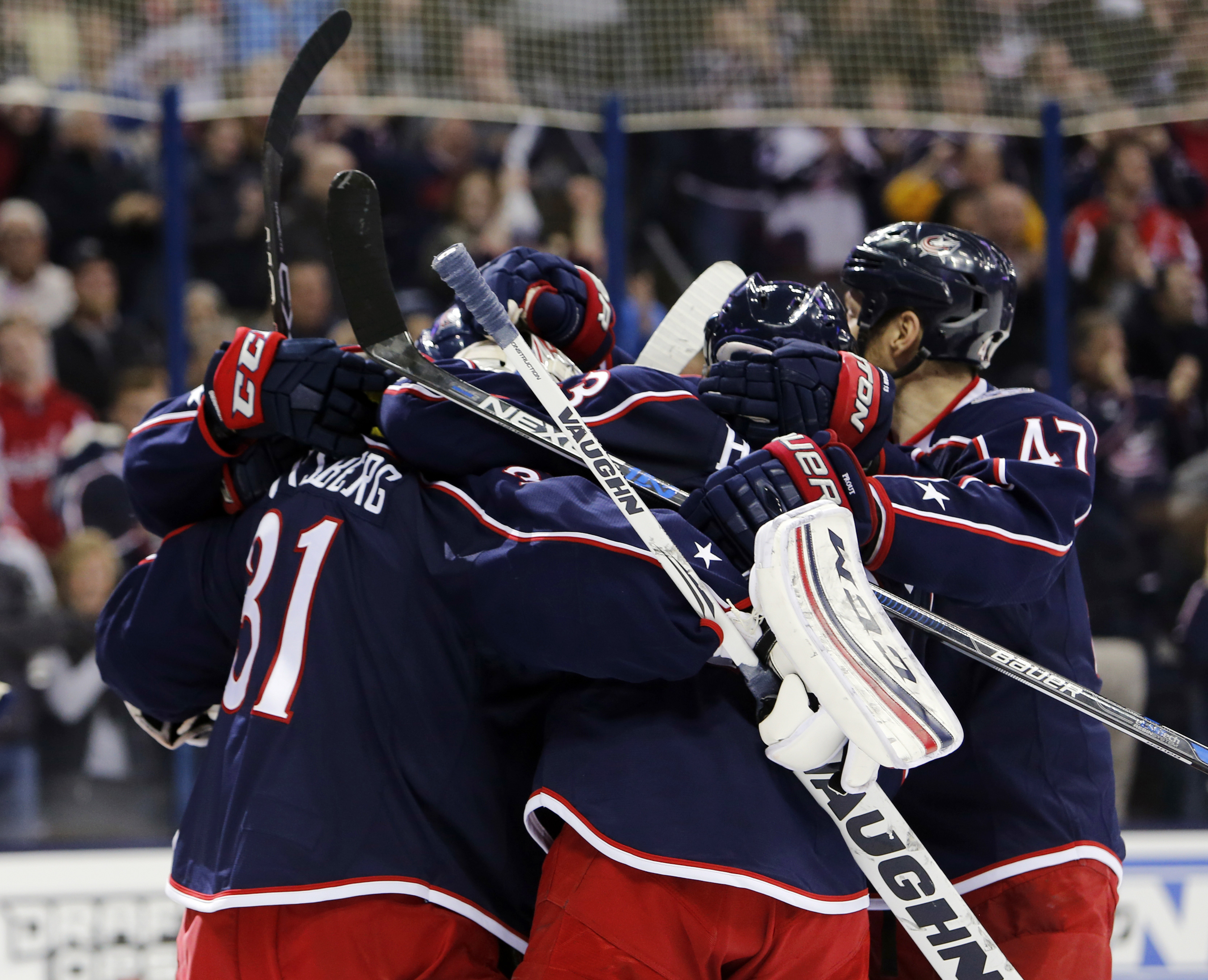 Columbus Blue Jackets' Anton Forsberg, left, of Sweden, is congratulated by teammates after making the final save of the shootout against the Washington Capitals in an NHL hockey game Saturday, Jan. 2, 2016, in Columbus, Ohio. Forsberg entered the game af