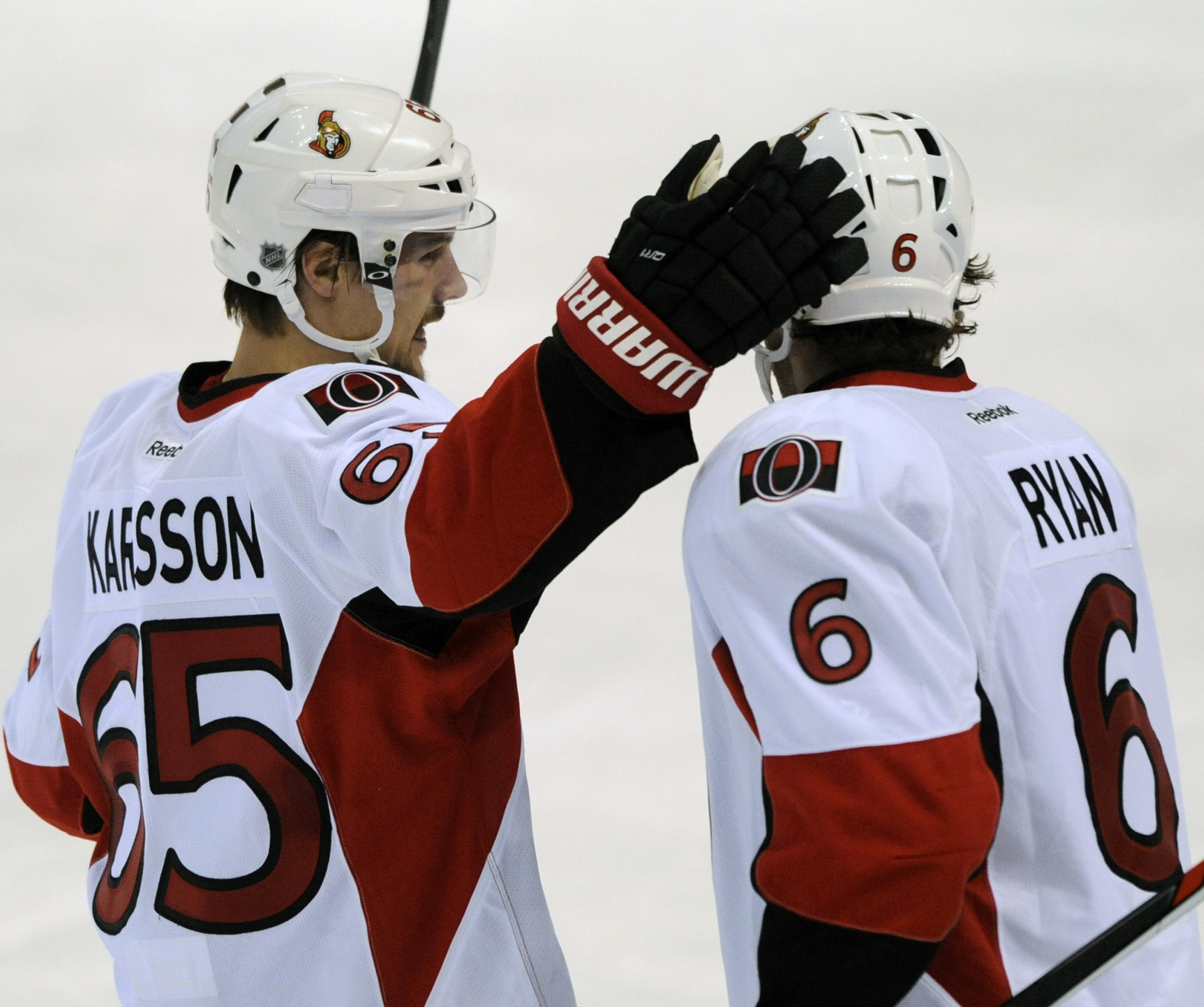 Ottawa Senators' Erik Karlsson (65), of Sweden, congratulates teammate Bobby Ryan (6) on his goal against the St. Louis Blues during the third period of an NHL hockey game, Monday, Jan. 4, 2016, in St. Louis. (AP Photo/Bill Boyce)