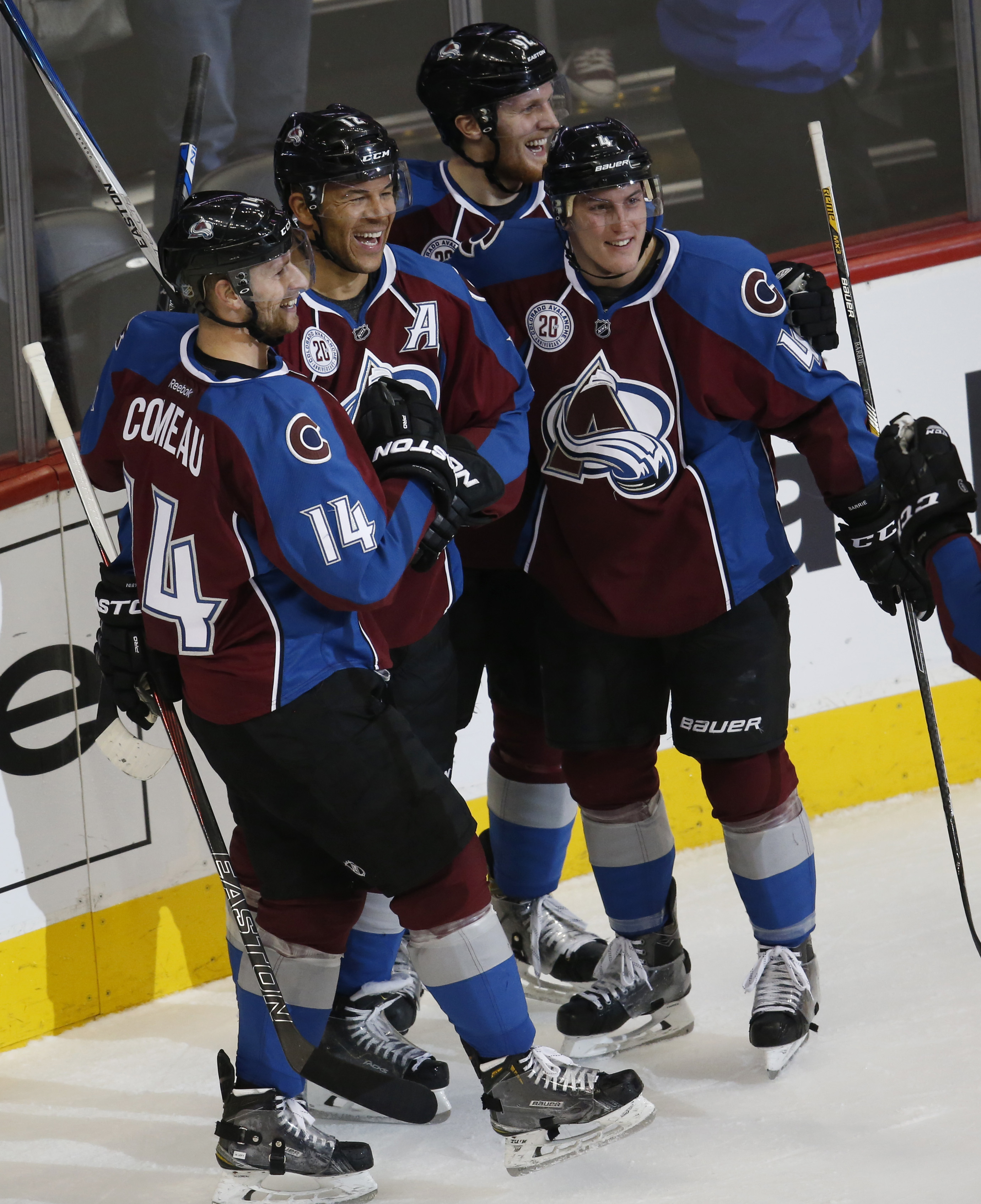 Colorado Avalanche right wing Jarome Iginla, second from left, celebrates scoring his 600th career goal with teammates, from left, left wing Blake Comeau,  defenseman Tyson Barrie, left wing Gabriel Landeskog, of Sweden, against the Los Angeles Kings in t
