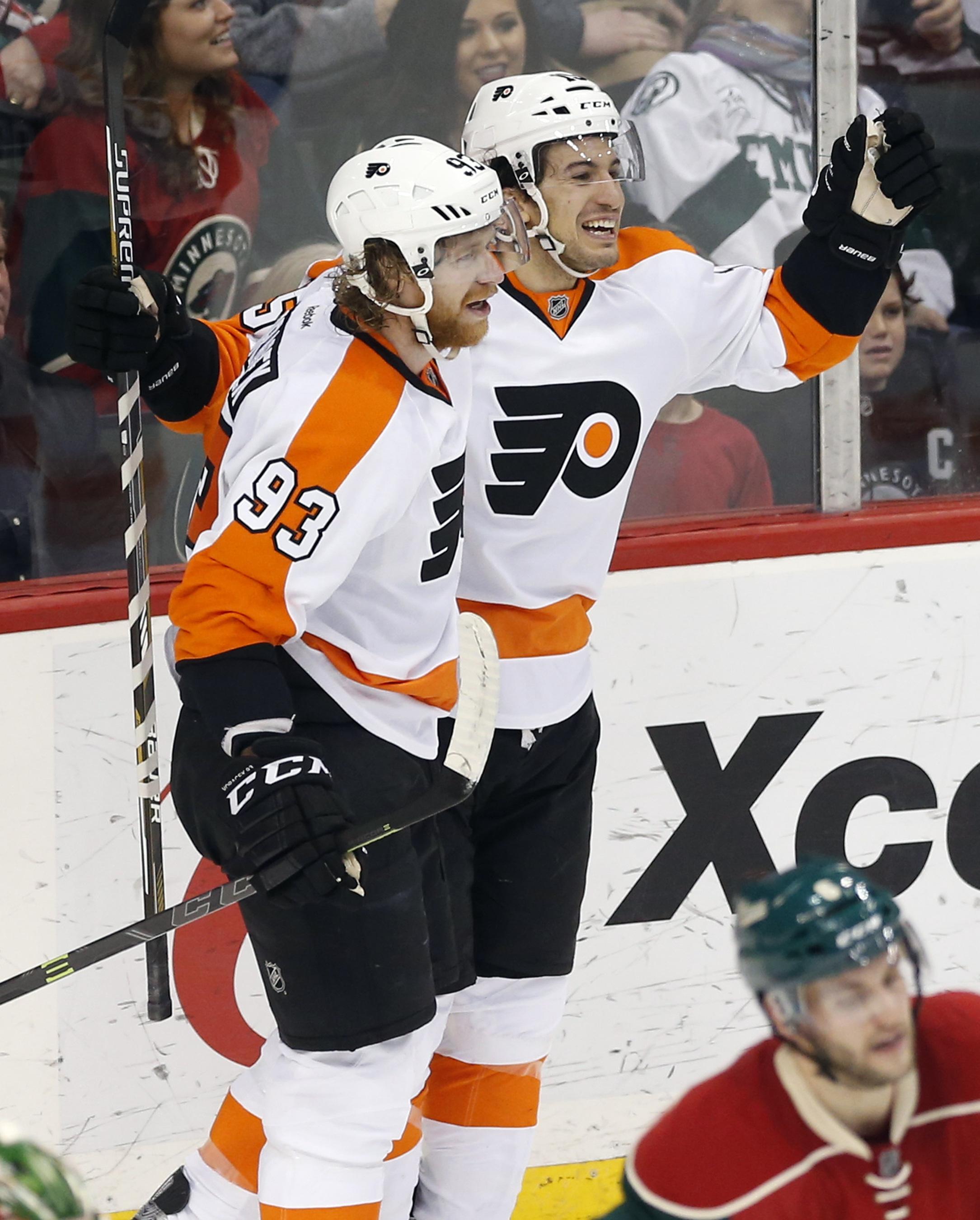 Philadelphia Flyers' Jakub Voracek, left, of Czech Republic, celebrates with Michael Del Zotto following Del Zotto's game-winning goal in overtime off Minnesota Wild goalie Devan Dubnyk in an NHL hockey game, Thursday, Jan. 7, 2016, in St. Paul, Minn. The