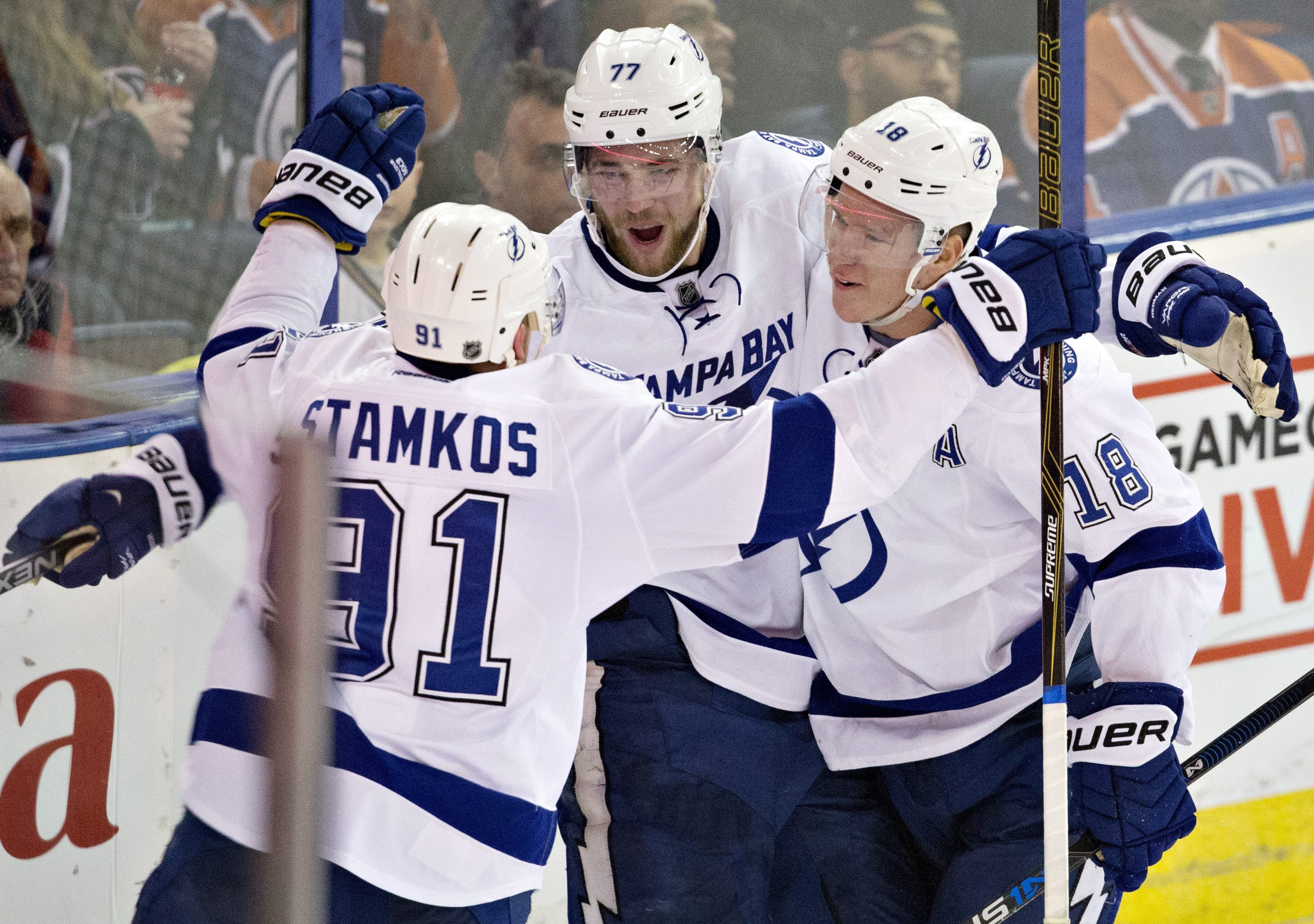 Tampa Bay Lightning's Steven Stamkos (91), Victor Hedman (77) and Ondrej Palat (18) celebrate a goal against the Edmonton Oilers during the third period of an NHL hockey game Friday, Jan. 8, 2016, in Edmonton, Alberta. (Jason Franson/The Canadian Press vi
