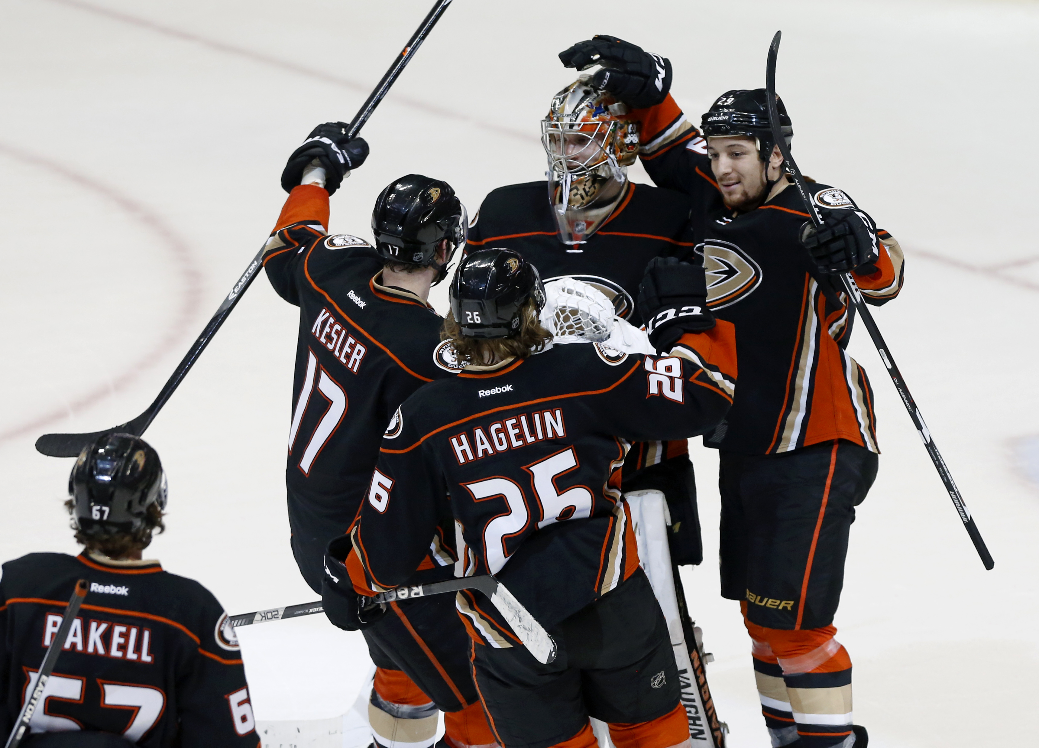 Anaheim Ducks goalie John Gibson and teammates Ryan Kesler (17), Carl Hagelin (26), and Chris Stewart (29) celebrate a 4-3 victory over the St. Louis Blues, after the shootout in the NHL hockey game in Anaheim, Calif., Friday, Jan. 8, 2016. (AP Photo/Chri