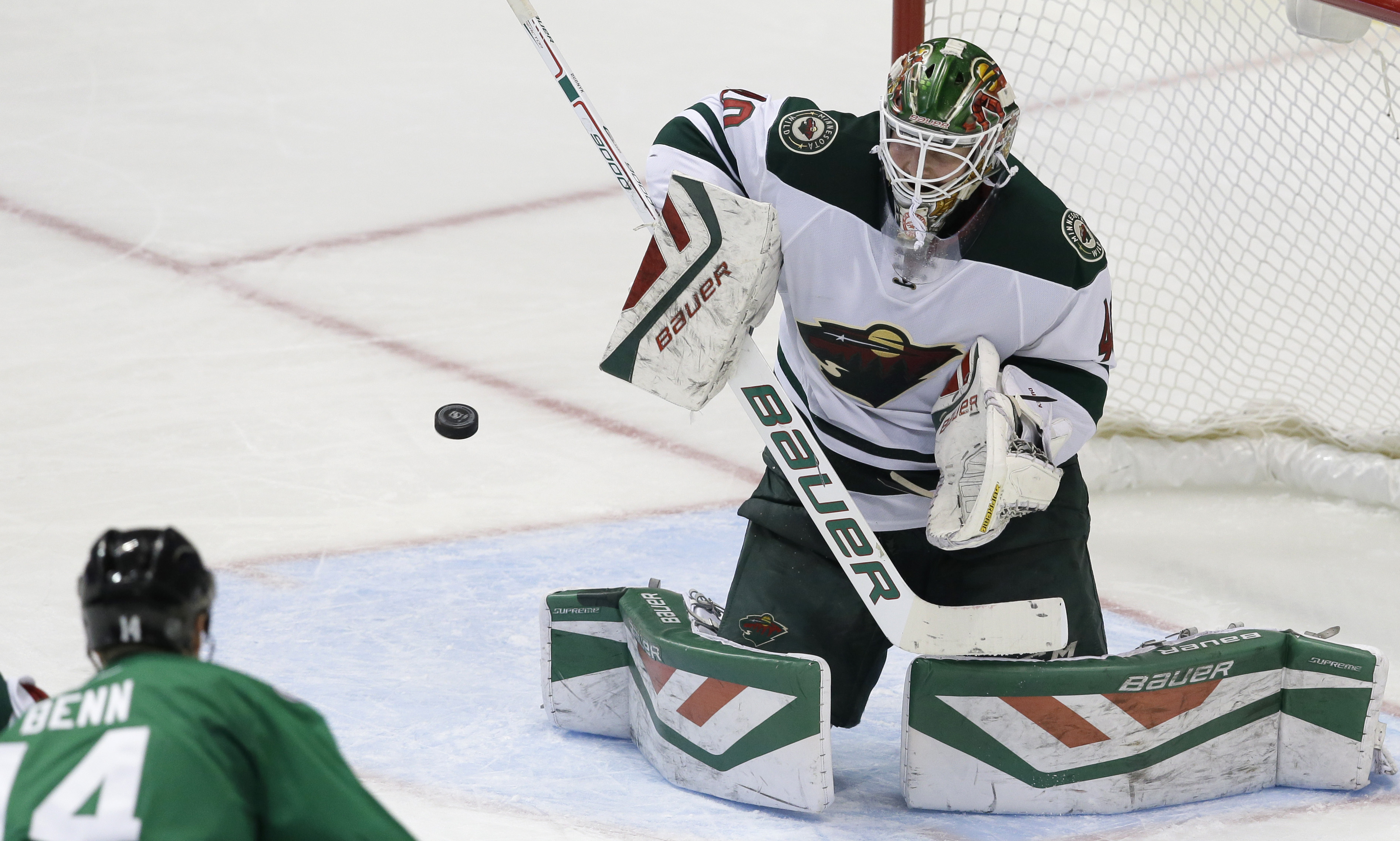 Minnesota Wild goalie Devan Dubnyk (40) defends the goal against Dallas Stars left wing Jamie Benn (14) during the second period of an NHL hockey game Saturday, Jan. 9, 2016, in Dallas. (AP Photo/LM Otero)