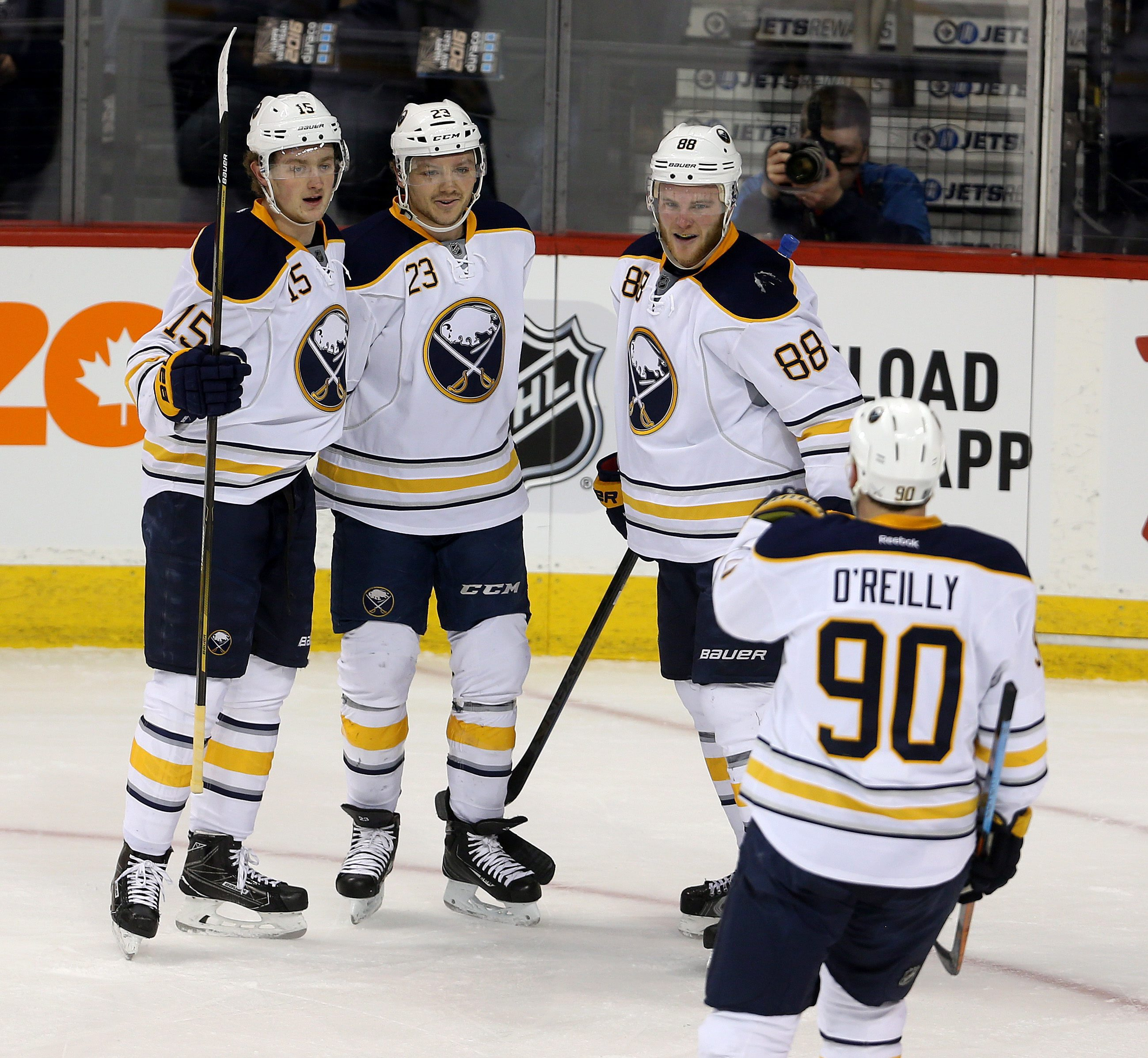 Buffalo Sabres' Jack Eichel (15), Sam Reinhart (23), Jamie McGinn (88) and Ryan O'Reilly (90) celebrate after Reinhart scored his second goal of the first period during NHL hockey game action against the Winnipeg Jets' in Winnipeg, Manitoba, Sunday, Jan.