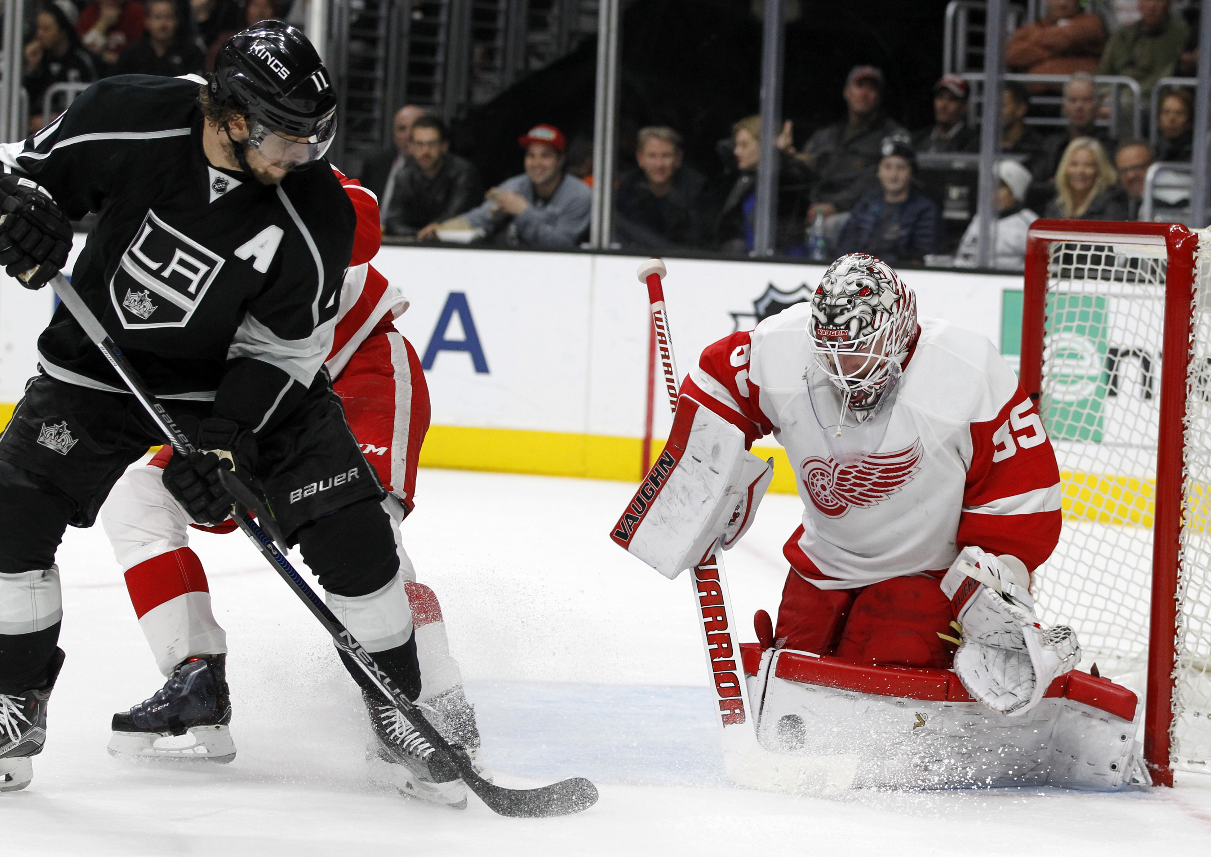 Detroit Red Wings goalie Jimmy Howard, right, blocks a shot by Los Angeles Kings center Anze Kopitar, left, of Slovenia, during the second period of an NHL hockey game in Los Angeles, Monday, Jan. 11, 2016. (AP Photo/Alex Gallardo)