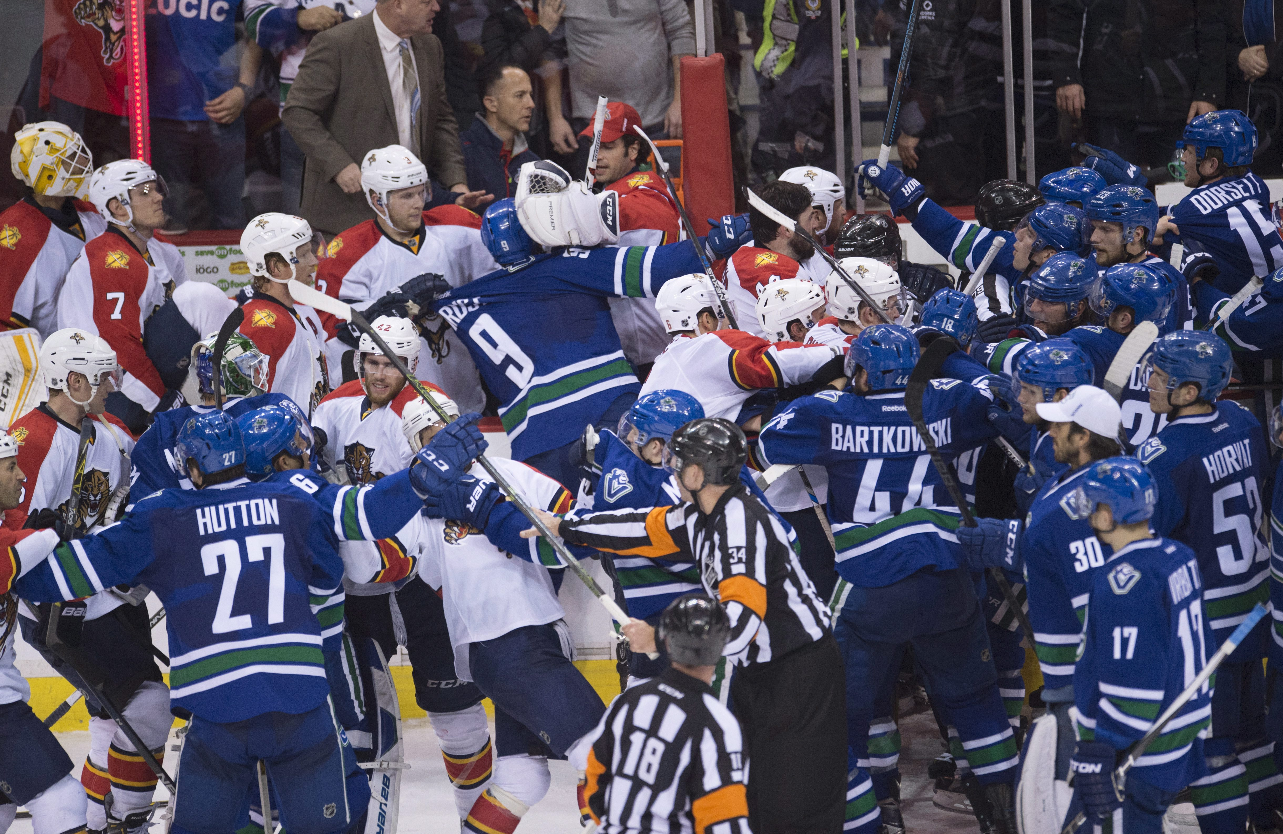 A bench clearing brawl breaks out following the Vancouver Canucks overtime win over the Florida Panthers in an NHL hockey game in Vancouver, British Columbia, Canada, Monday, Jan. 11, 2016. (Jonathan Hayward/The Canadian Press via AP)
