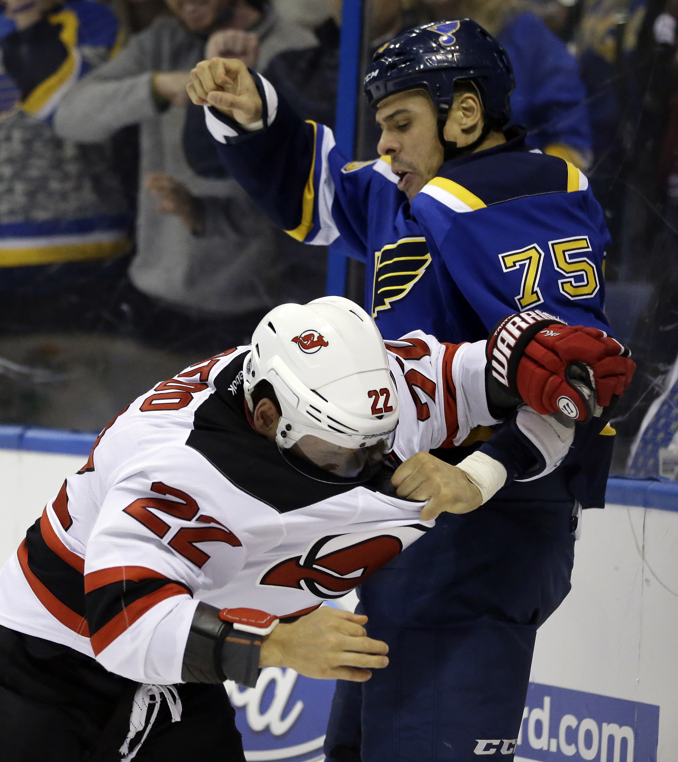 St. Louis Blues' Ryan Reaves (75) and New Jersey Devils' Jordin Tootoo fight during the third period of an NHL hockey game, Tuesday, Jan. 12, 2016, in St. Louis. The Blues won 5-2. (AP Photo/Jeff Roberson)