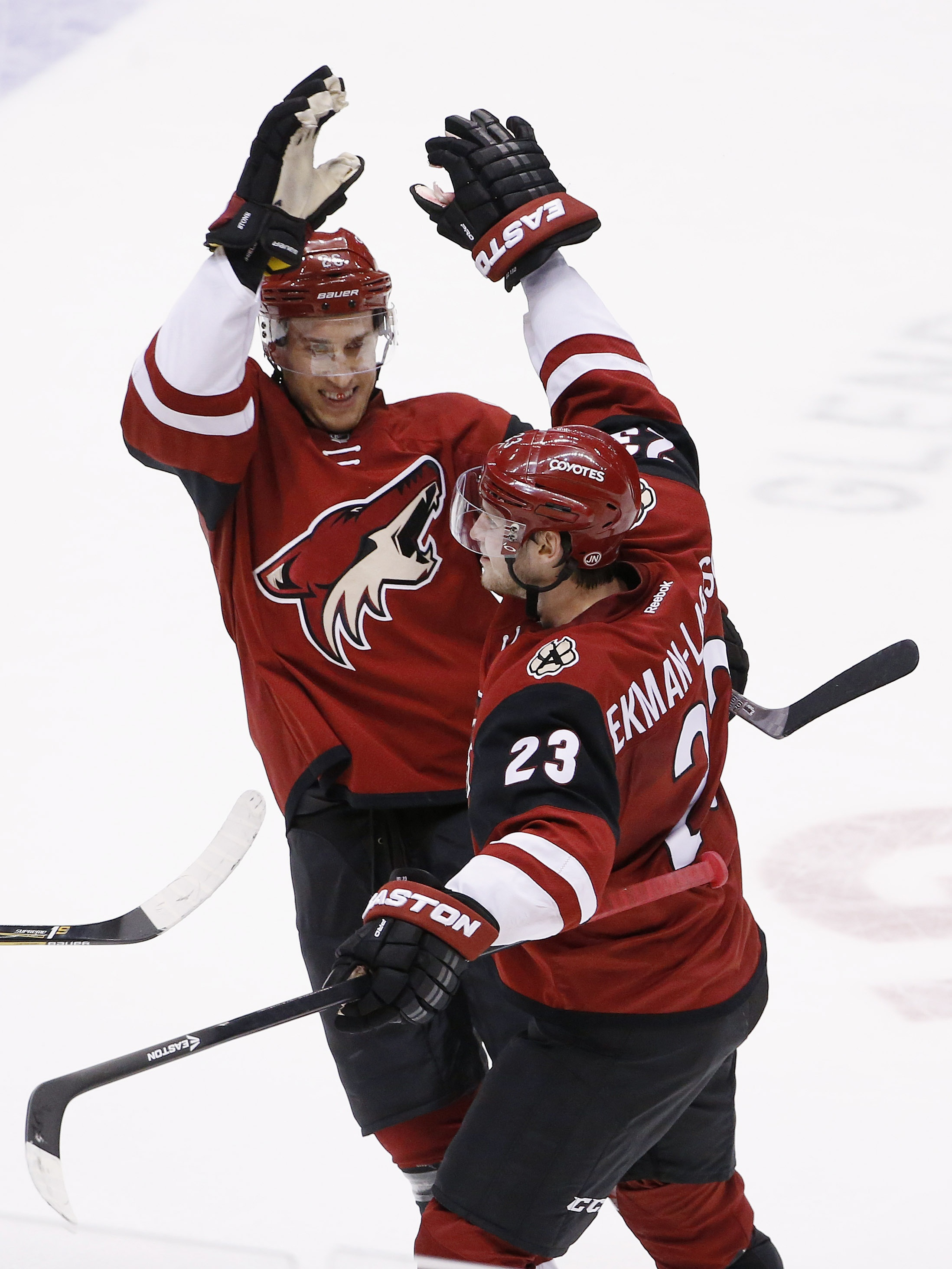 Arizona Coyotes' Oliver Ekman-Larsson (23), of Sweden, celebrates his game-winning goal against the Edmonton Oilers with Michael Stone, left, during overtime of an NHL hockey game Tuesday, Jan. 12, 2016, in Glendale, Ariz. The Coyotes defeated the Oilers