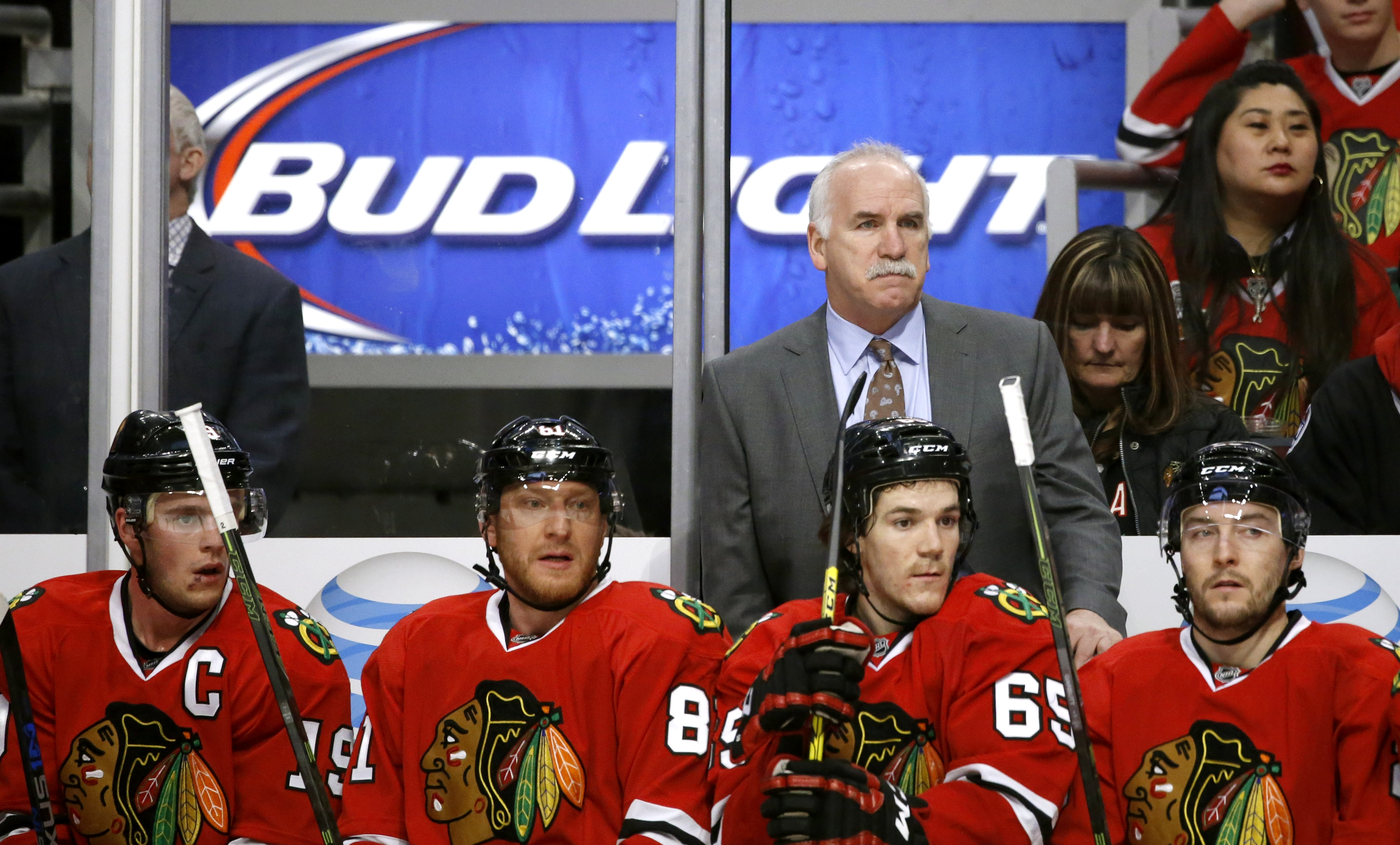 In this Jan. 12, 2016, photo, Chicago Blackhawks head coach Joel Quenneville directs his team during the first period of an NHL hockey game against the Nashville Predators, in Chicago. The 57-year-old former defenseman is the right coach in the right plac