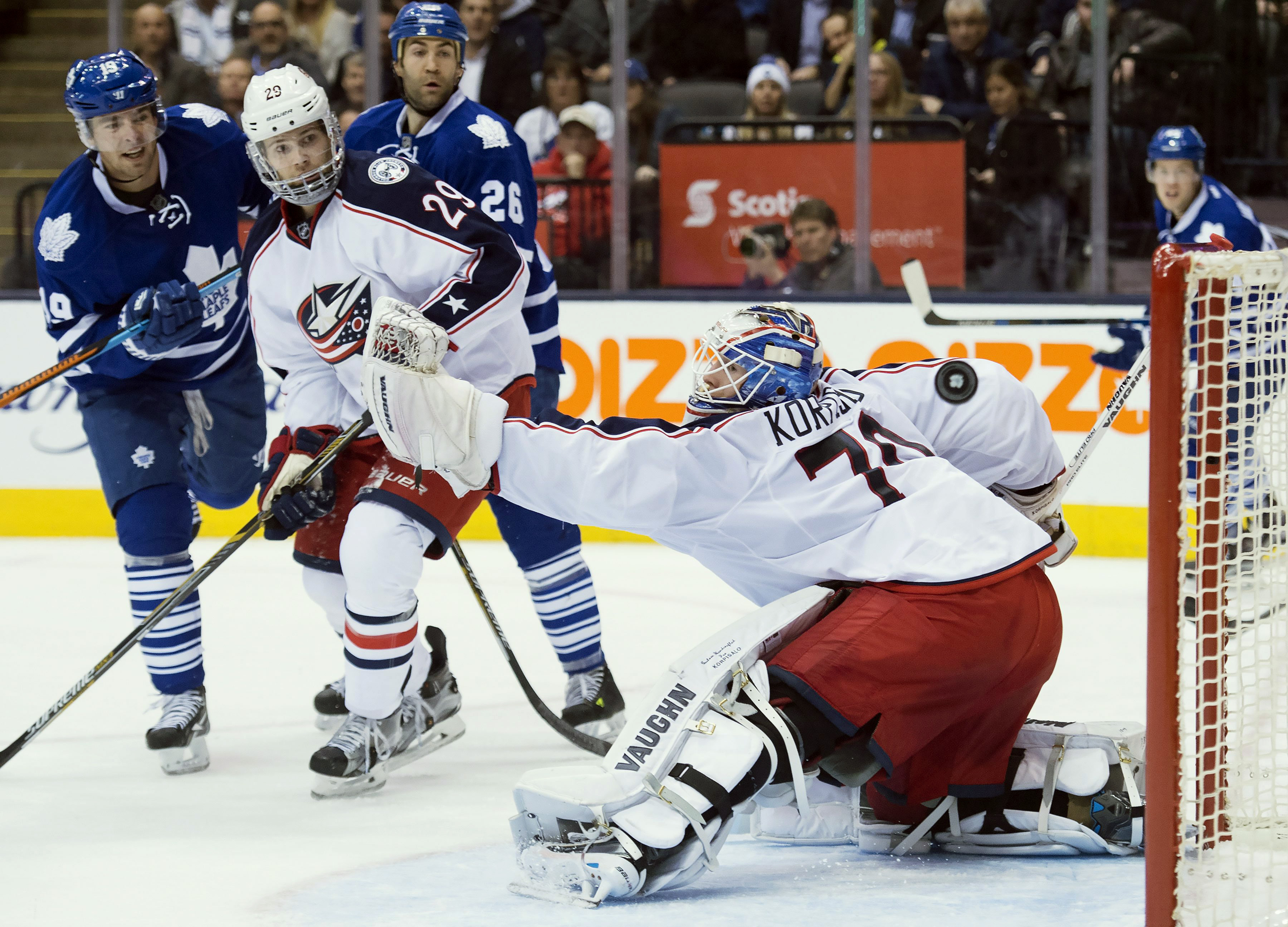 Toronto Maple Leafs right wing Joffrey Lupul (19) shoots the puck wide on Columbus Blue Jackets goalie Joonas Korpisalo (70) as Blue Jackets defenseman Cody Goloubef (29) keeps close during the second period of an NHL hockey game in Toronto, Wednesday, Ja