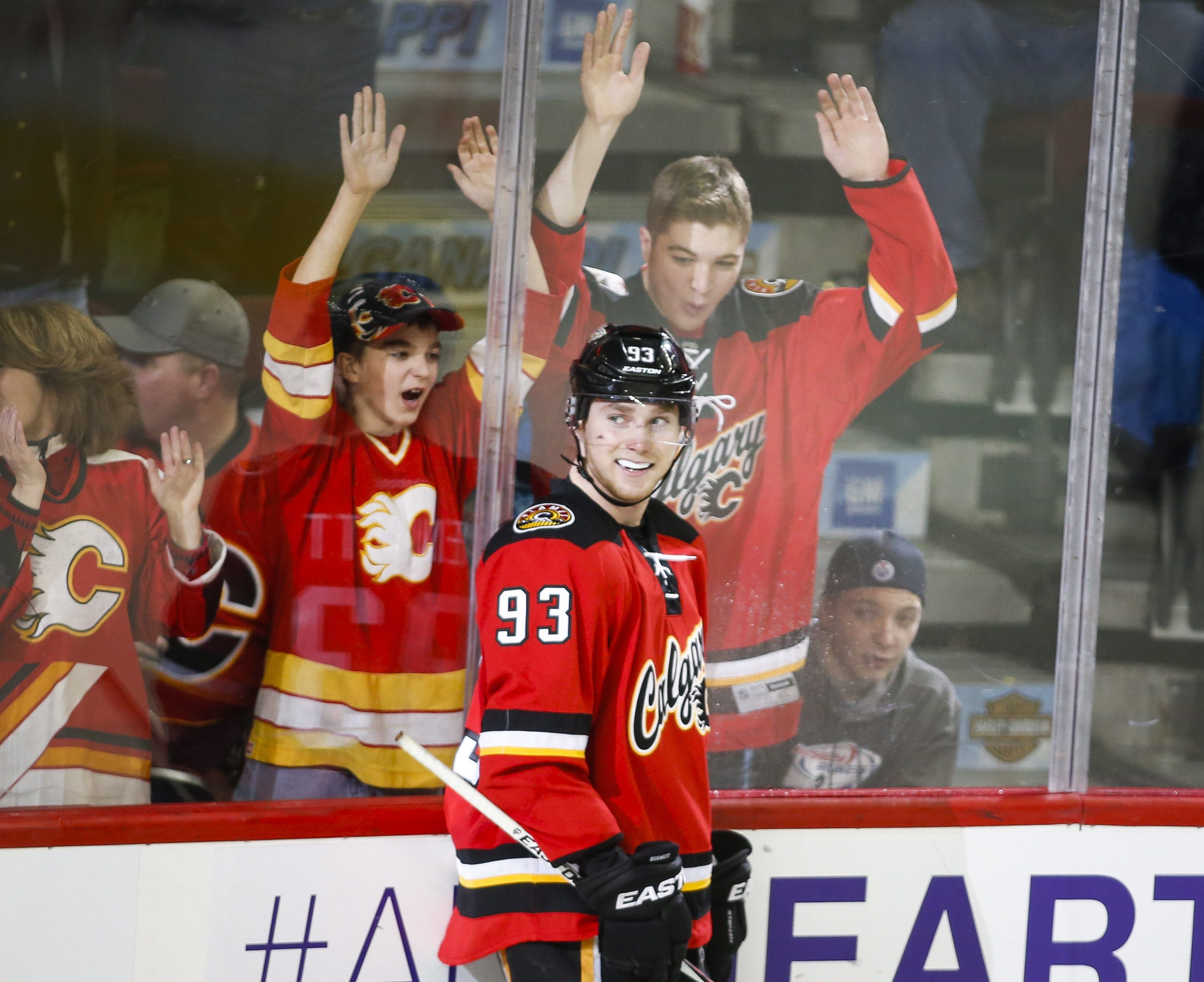Calgary Flames' Sam Bennett celebrate his fourth goal during the third period of an NHL hockey game Wednesday, Jan. 13, 2016, in Calgary, Alberta. (Jeff McIntosh/The Canadian Press via AP)