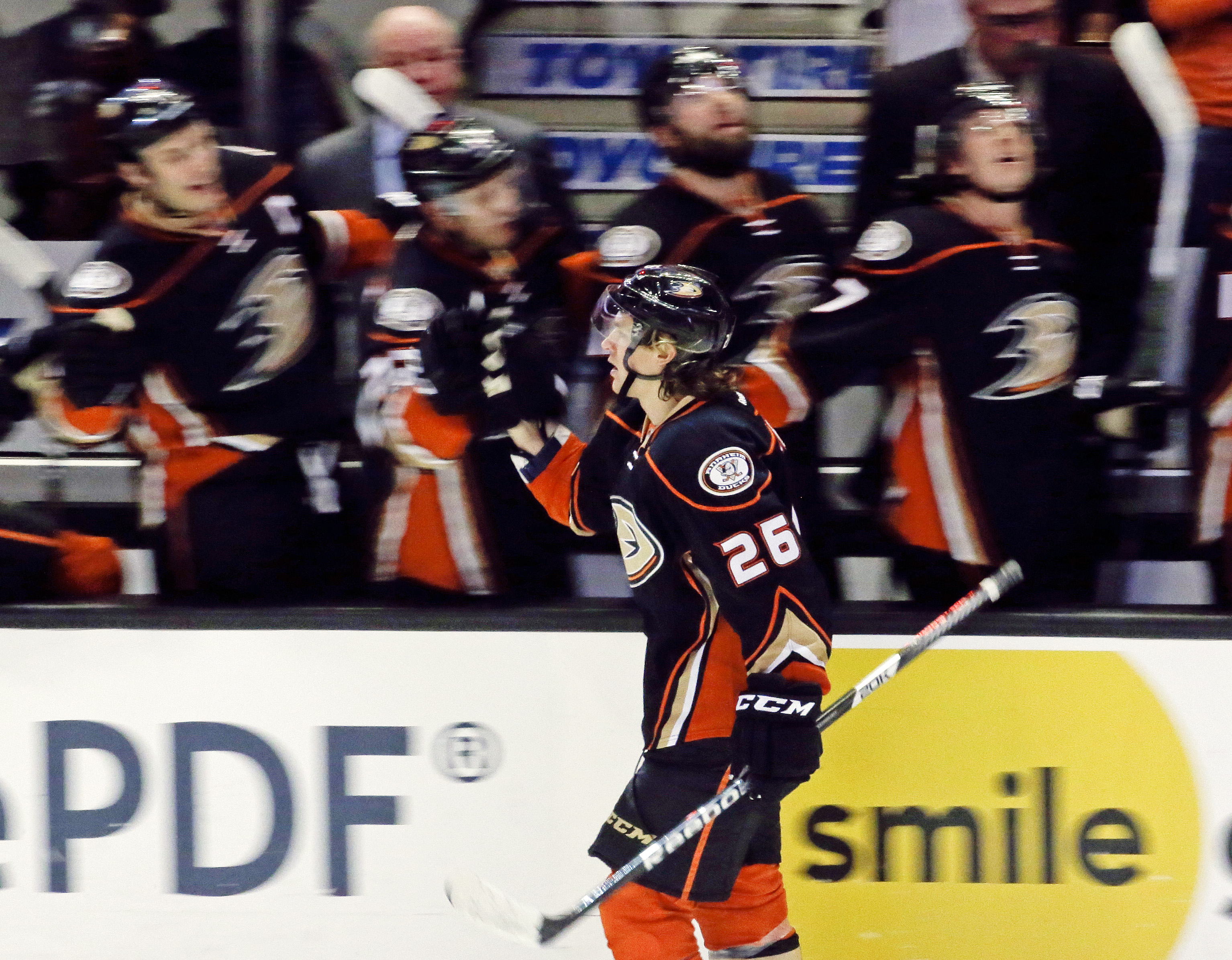 Anaheim Ducks left wing Carl Hagelin celebrates with the bench after scoring during the third period of an NHL hockey game against the Ottawa Senators in Anaheim, Calif., Wednesday, Jan. 13, 2016. The Ducks won 4-1. (AP Photo/Chris Carlson)