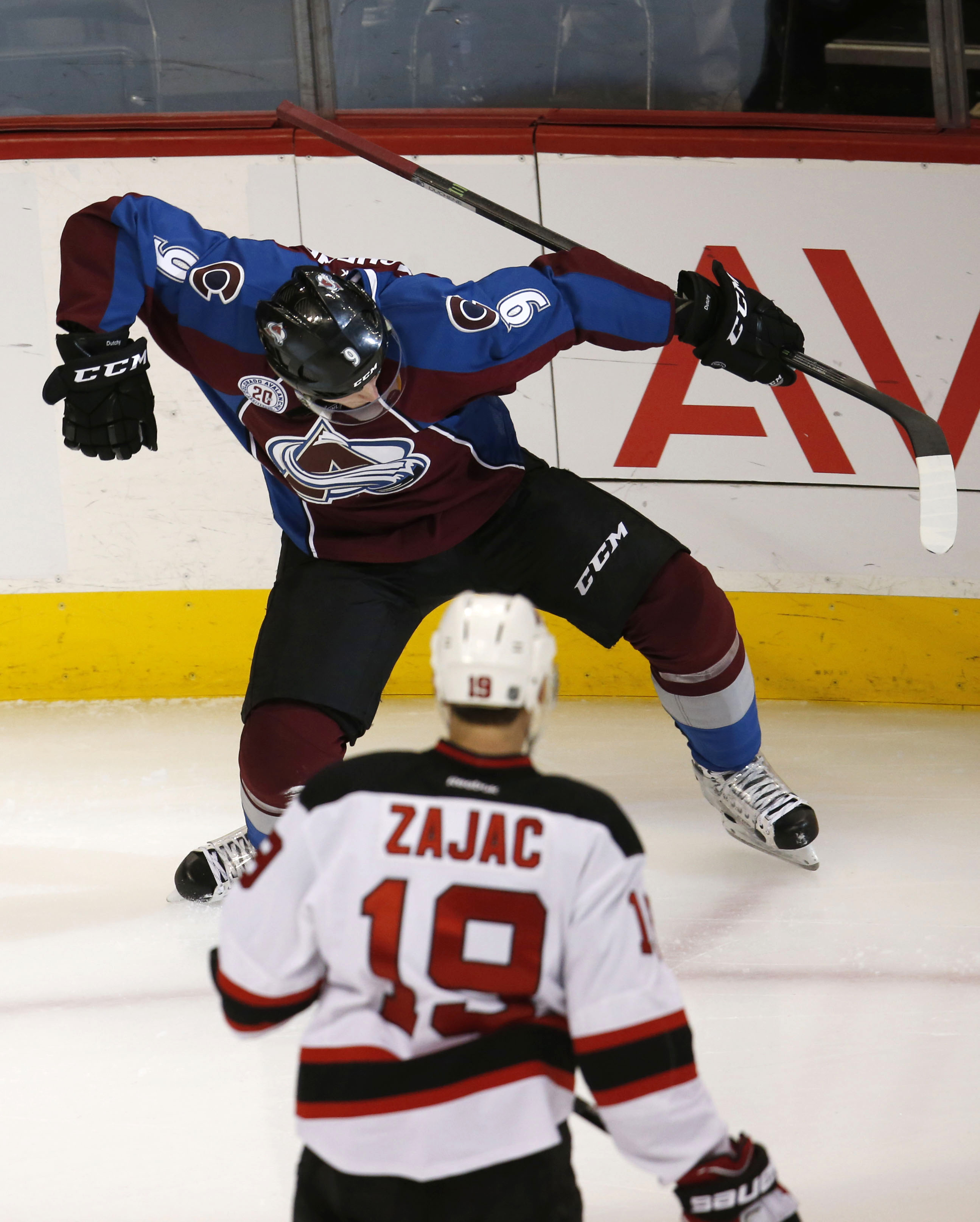 Colorado Avalanche center Matt Duchene, top, celebrates his goal as New Jersey Devils center Travis Zajac watches during the first period of an NHL hockey game Thursday, Jan. 14, 2016, in Denver. (AP Photo/David Zalubowski)