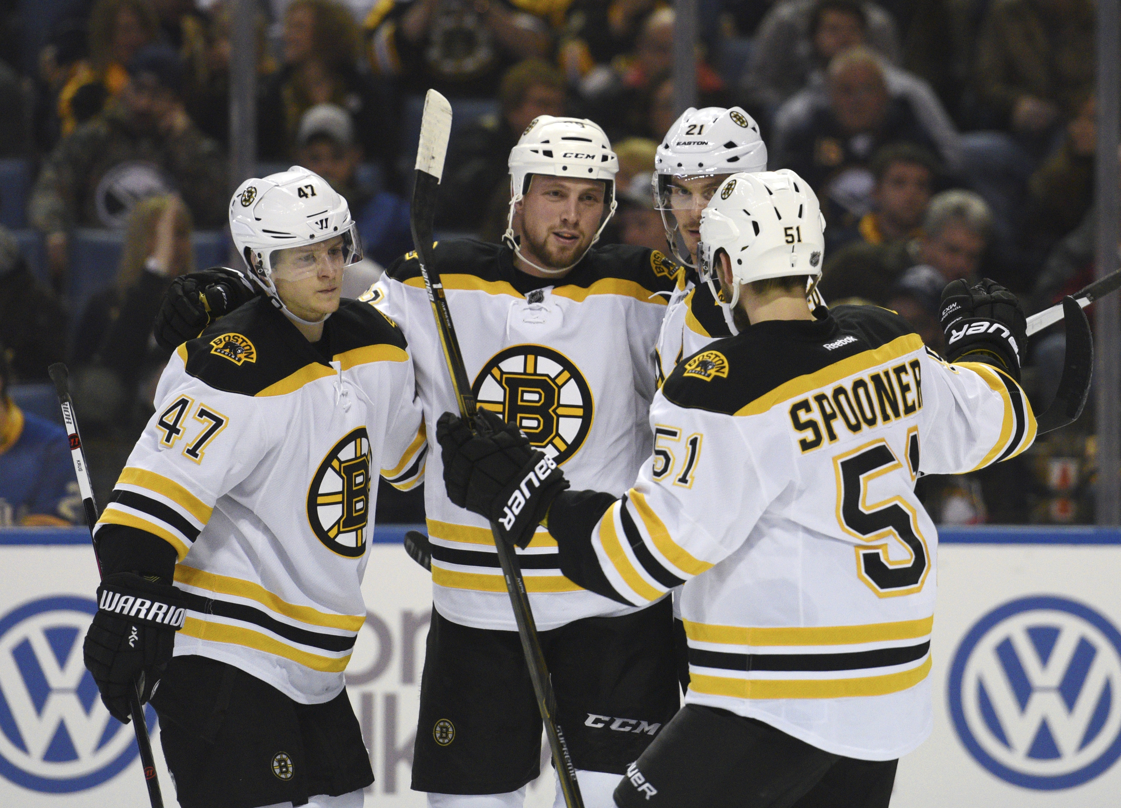 Boston Bruins' Torey Krug (47), Matt Beleskey (39), Loui Ericsson (21) and Ryan Spooner (51) celebrate a goal by Beleskey during the second period of an NHL hockey game against the Buffalo Sabres, Friday, Jan. 15, 2016, in Buffalo, N.Y. (AP Photo/Gary Wie