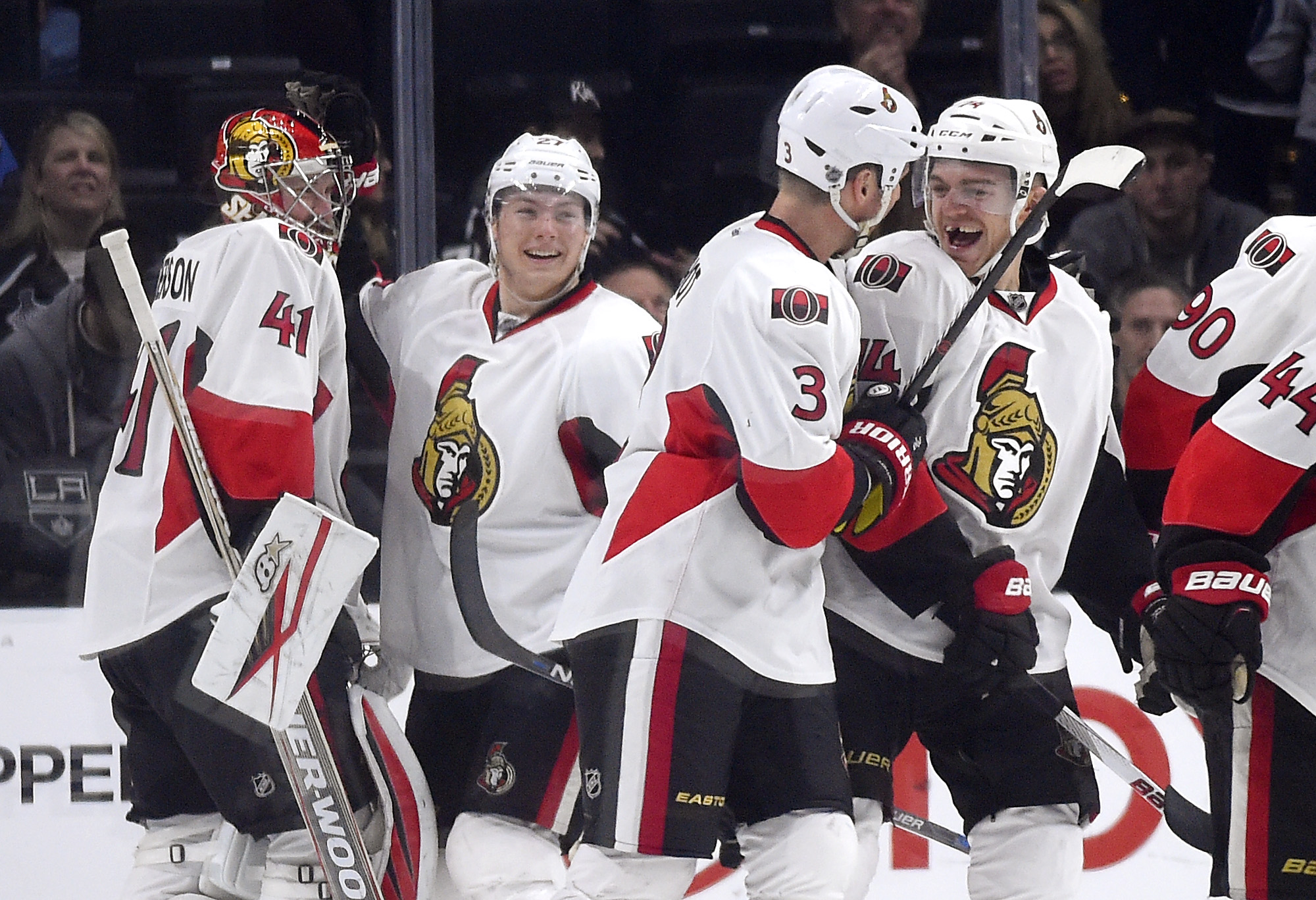 Ottawa Senators defenseman Mark Borowiecki, right, celebrates his goal with defenseman Marc Methot, second from right, as goalie Craig Anderson, left, celebrates with right wing Curtis Lazar during the third period of an NHL hockey game against the Los An