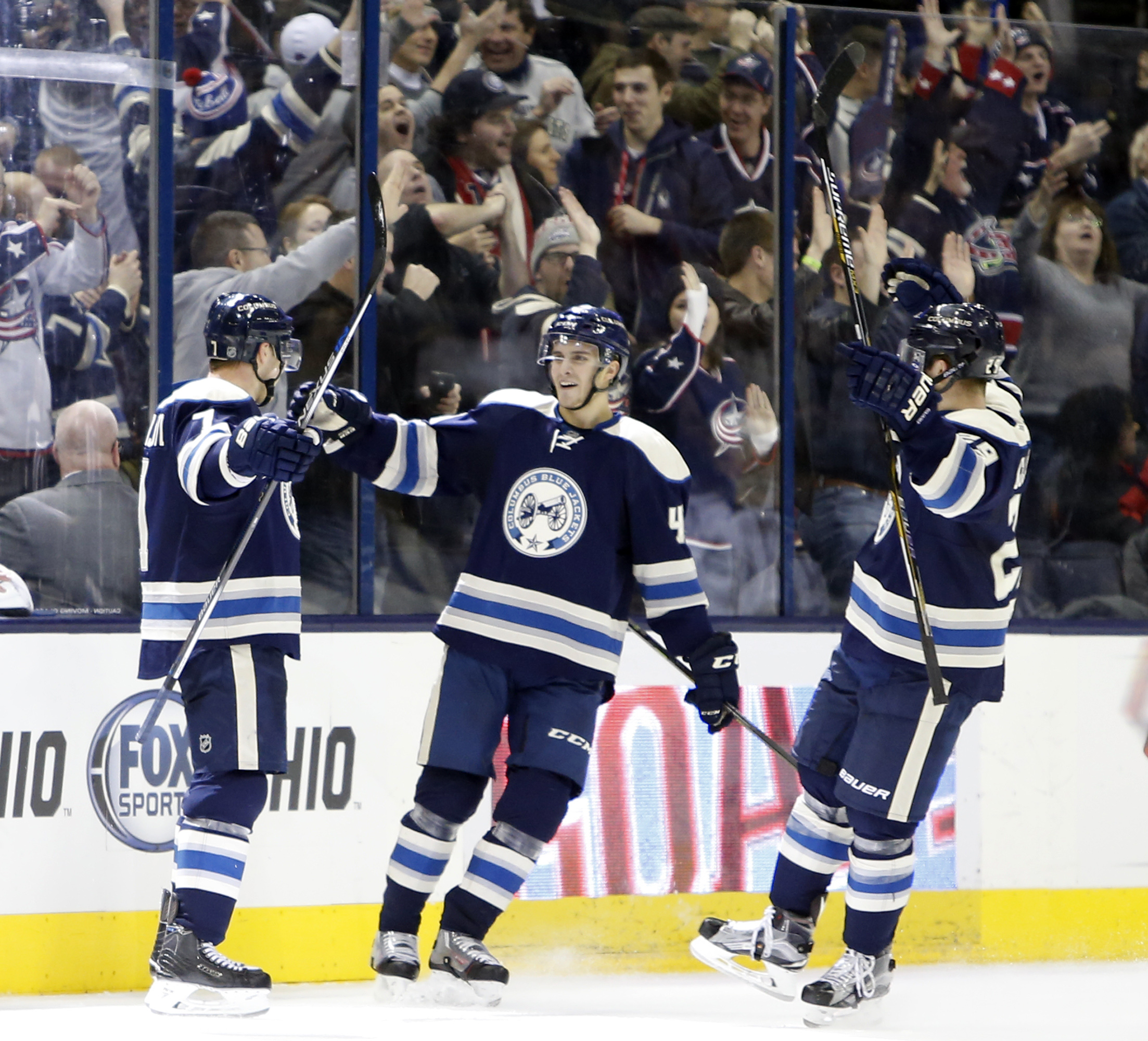 Columbus Blue Jackets' Jack Johnson, left, celebrates his winning goal against the Colorado Avalanche with teammates Alexander Wennberg, center, of Sweden, and Cody Goloubef during the third period of an NHL hockey game Saturday, Jan. 16, 2016, in Columbu