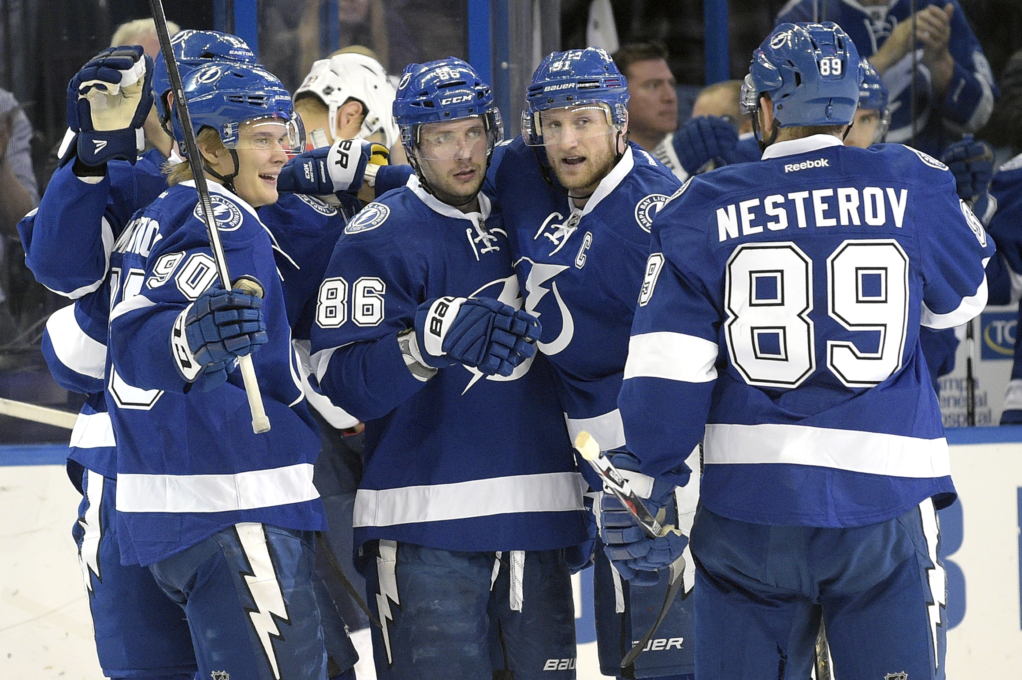 Tampa Bay Lightning right wing Nikita Kucherov (86), of Russia, is congratulated by center Vladislav Namestnikov (90), of Russia, center Steven Stamkos (91) and defenseman Nikita Nesterov (89), of Russia, after scoring during the second period of an NHL h