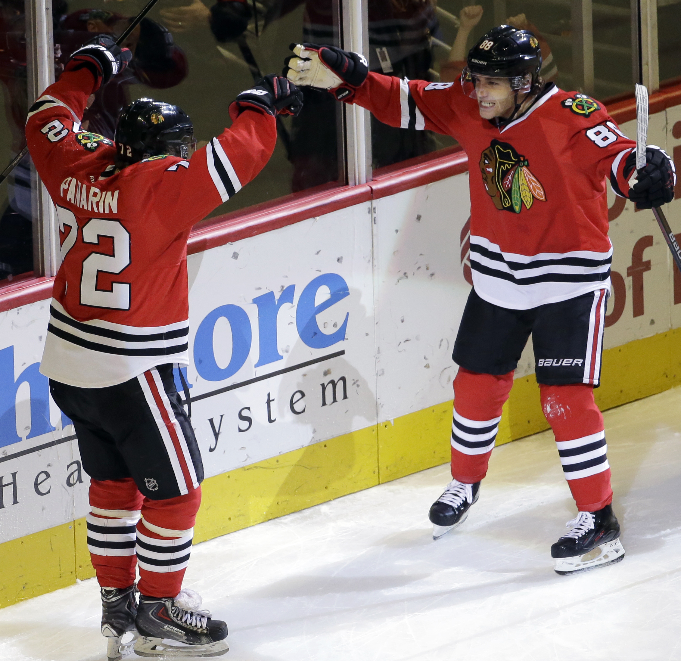 Chicago Blackhawks right wing Patrick Kane, right, celebrates with left wing Artemi Panarin after scoring his goal during the third period of an NHL hockey game against the Montreal Canadiens Sunday, Jan. 17, 2016, in Chicago. The Blackhawks won 5-2. (AP