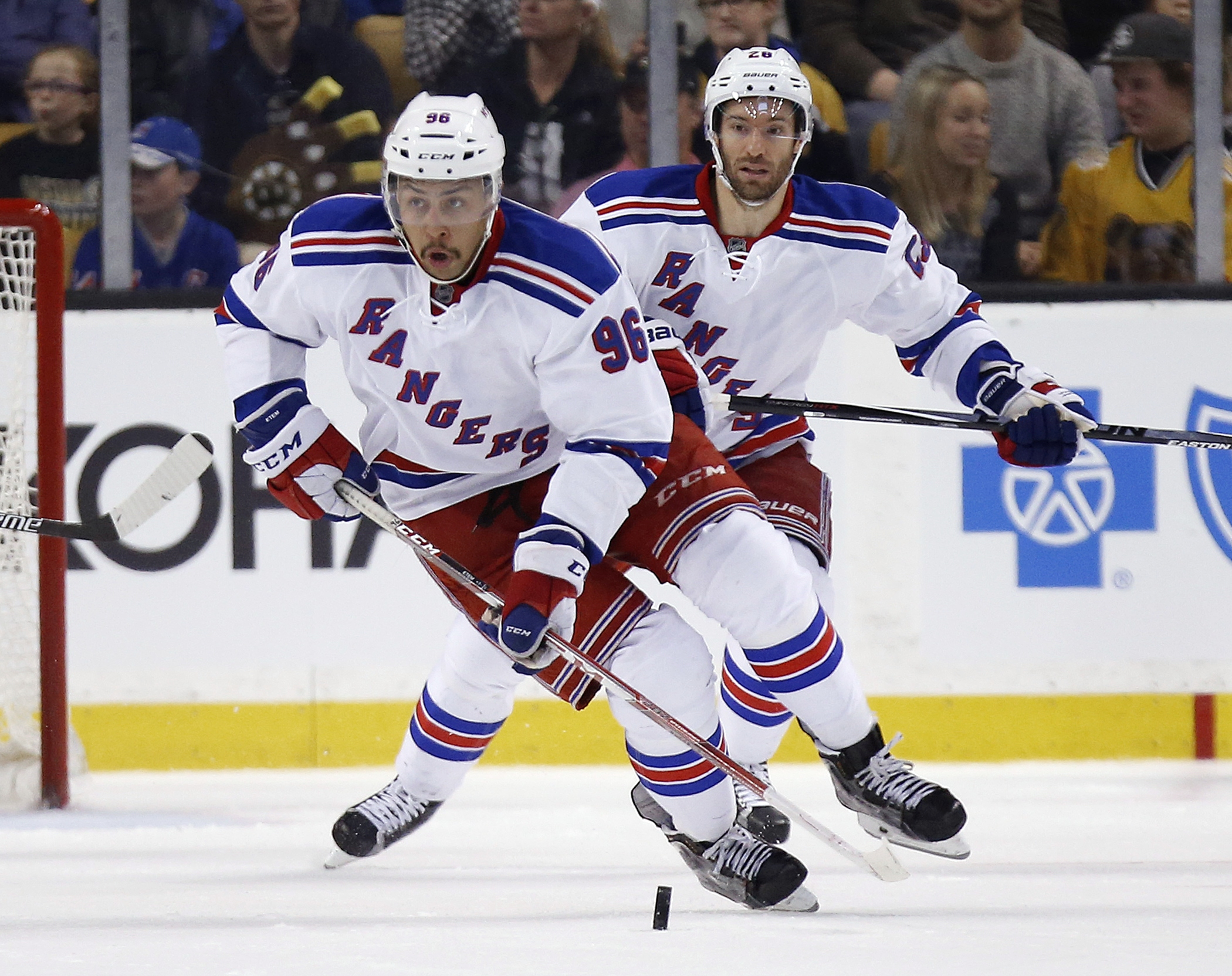 FILE - In this Nov. 27, 2015, file photo, then-New York Rangers' Emerson Etem (96) brings the puck up in front of teammate Dominic Moore (28) during the third period of an NHL hockey game against the Boston Bruins,  in Boston. Following an offseason trade