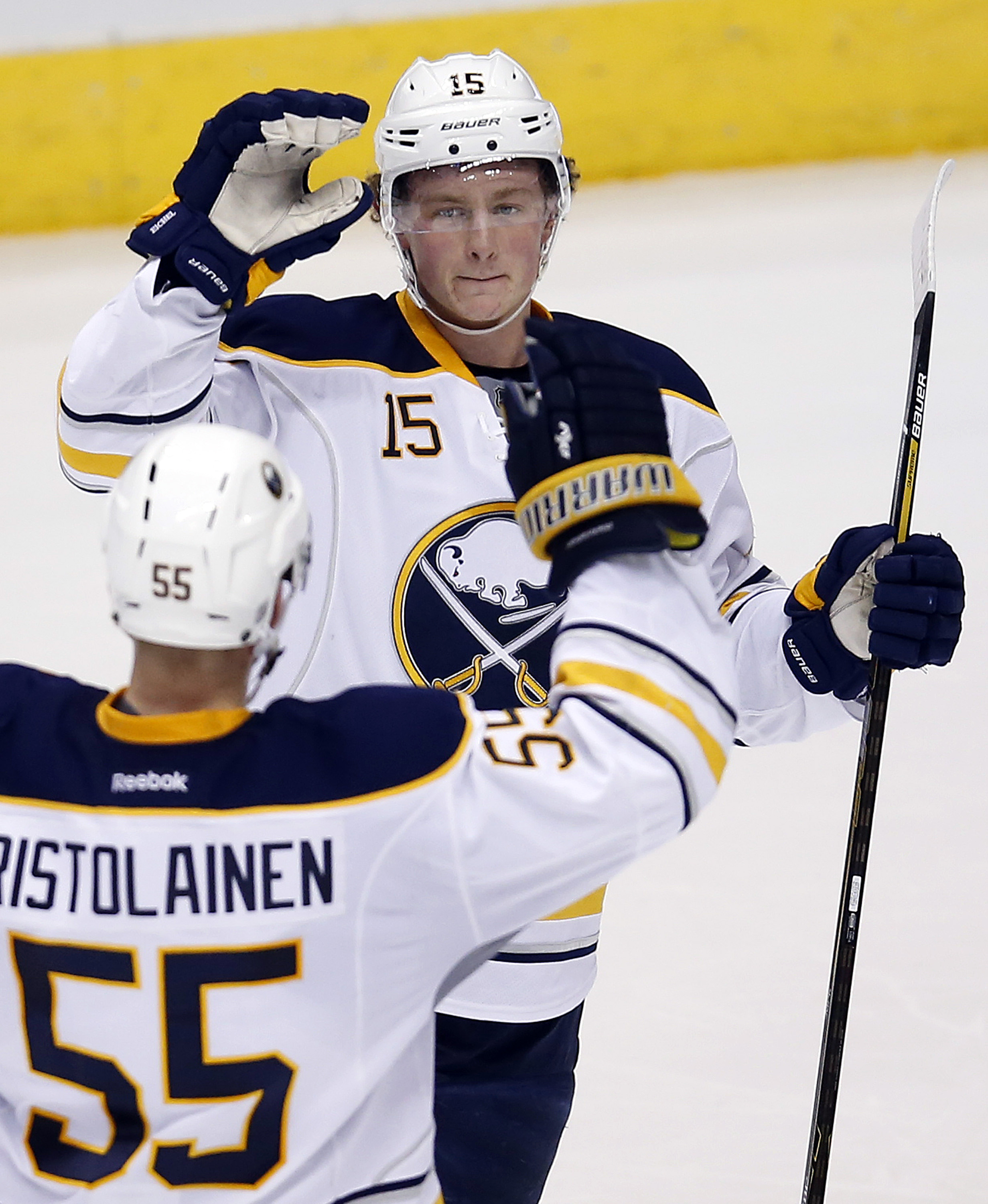 Buffalo Sabres center Jack Eichel (15) celebrates with Rasmus Ristolainen (55) after scoring a goal in the second period during an NHL hockey game against the Arizona Coyotes, Monday, Jan. 18, 2016, in Glendale, Ariz. (AP Photo/Rick Scuteri)