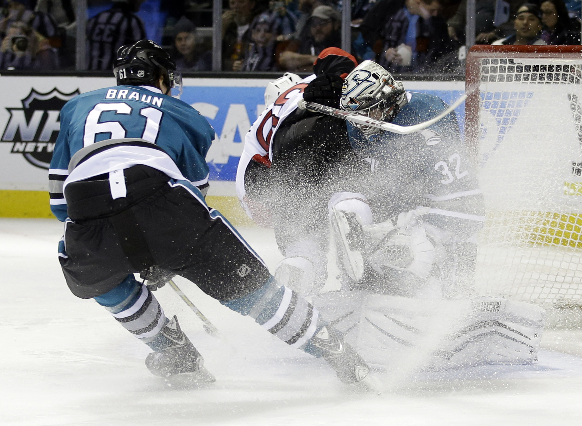 San Jose Sharks goalie Alex Stalock (32) collides with Ottawa Senators' Mike Hoffman, center, as Justin Braun (61) closes in during the second period of an NHL hockey game Monday, Jan. 18, 2016, in San Jose, Calif. (AP Photo/Marcio Jose Sanchez)