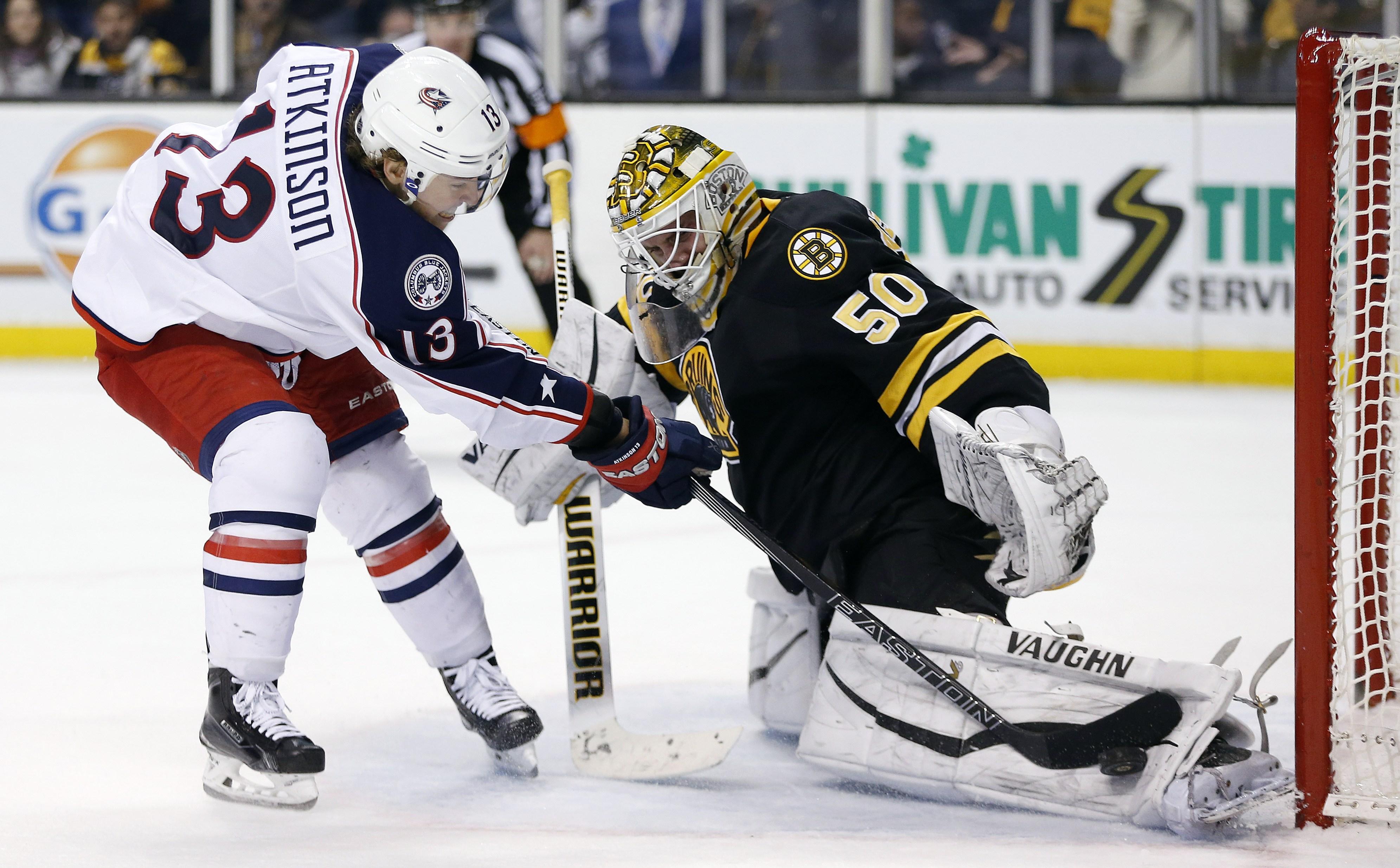 Boston Bruins' Jonas Gustavsson (50) blocks a shot by Columbus Blue Jackets' Cam Atkinson (13) during the shootout in an NHL hockey game in Boston, Saturday, Jan. 23, 2016. The Bruins won 3-2. (AP Photo/Michael Dwyer)