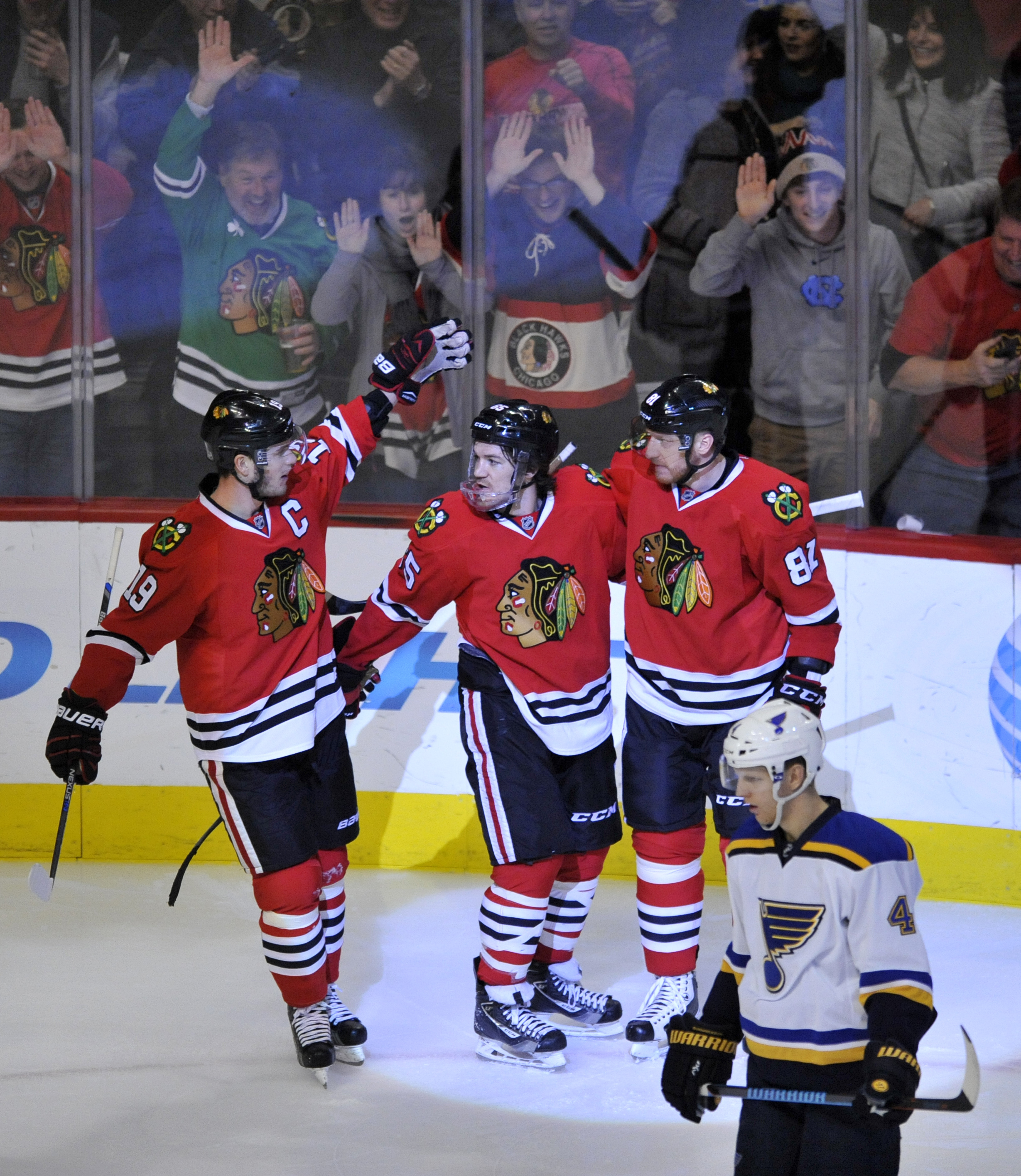 Chicago Blackhawks' Andrew Shaw (65) celebrates with teammates Jonathan Toews (19) and Marian Hossa (81), of Slovakia, after scoring a goal during the third period of a hockey game against the St. Louis Blues Sunday, Jan. 24, 2016, in Chicago. Chicago won