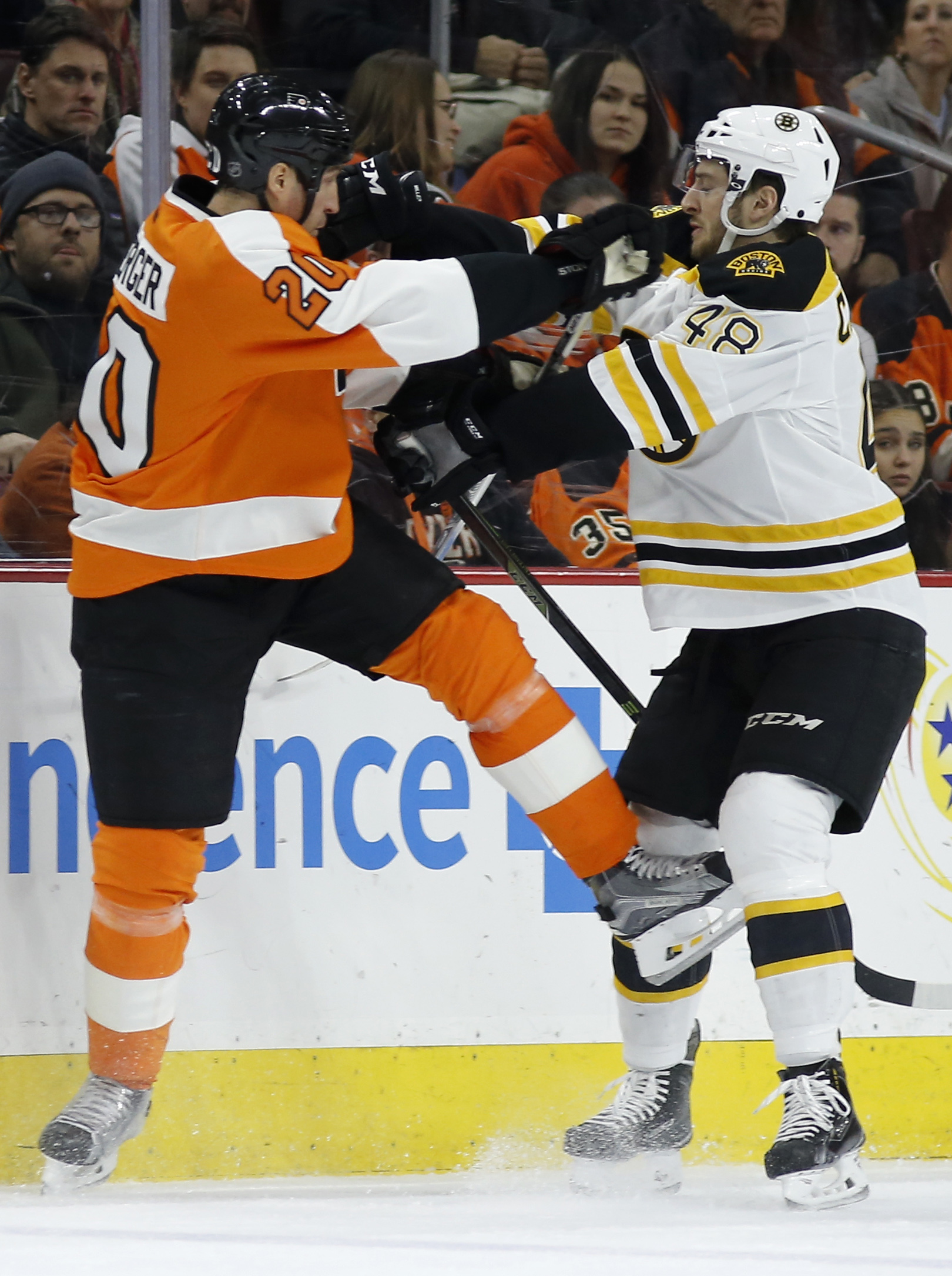 Philadelphia Flyers' R.J. Umberger, left, and Boston Bruins' Colin Miller collide during the first period of an NHL hockey game, Monday, Jan. 25, 2016, in Philadelphia. (AP Photo/Matt Slocum)