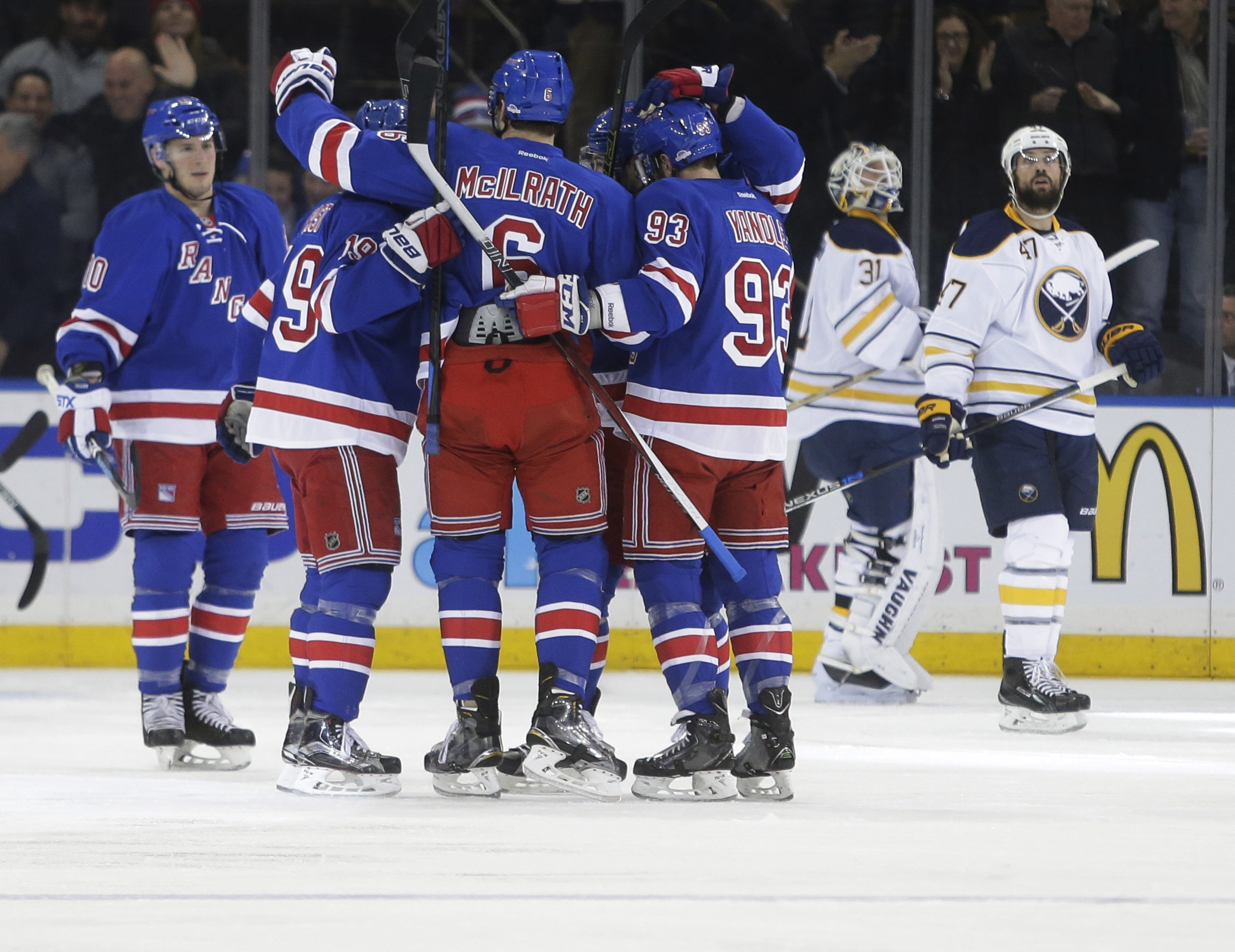 Buffalo Sabres goalie Chad Johnson (31) and Zach Bogosian (47) watch as the New York Rangers celebrate a goal by J.T. Miller during the first period of an NHL hockey game Monday, Jan. 25, 2016, in New York. (AP Photo/Frank Franklin II)