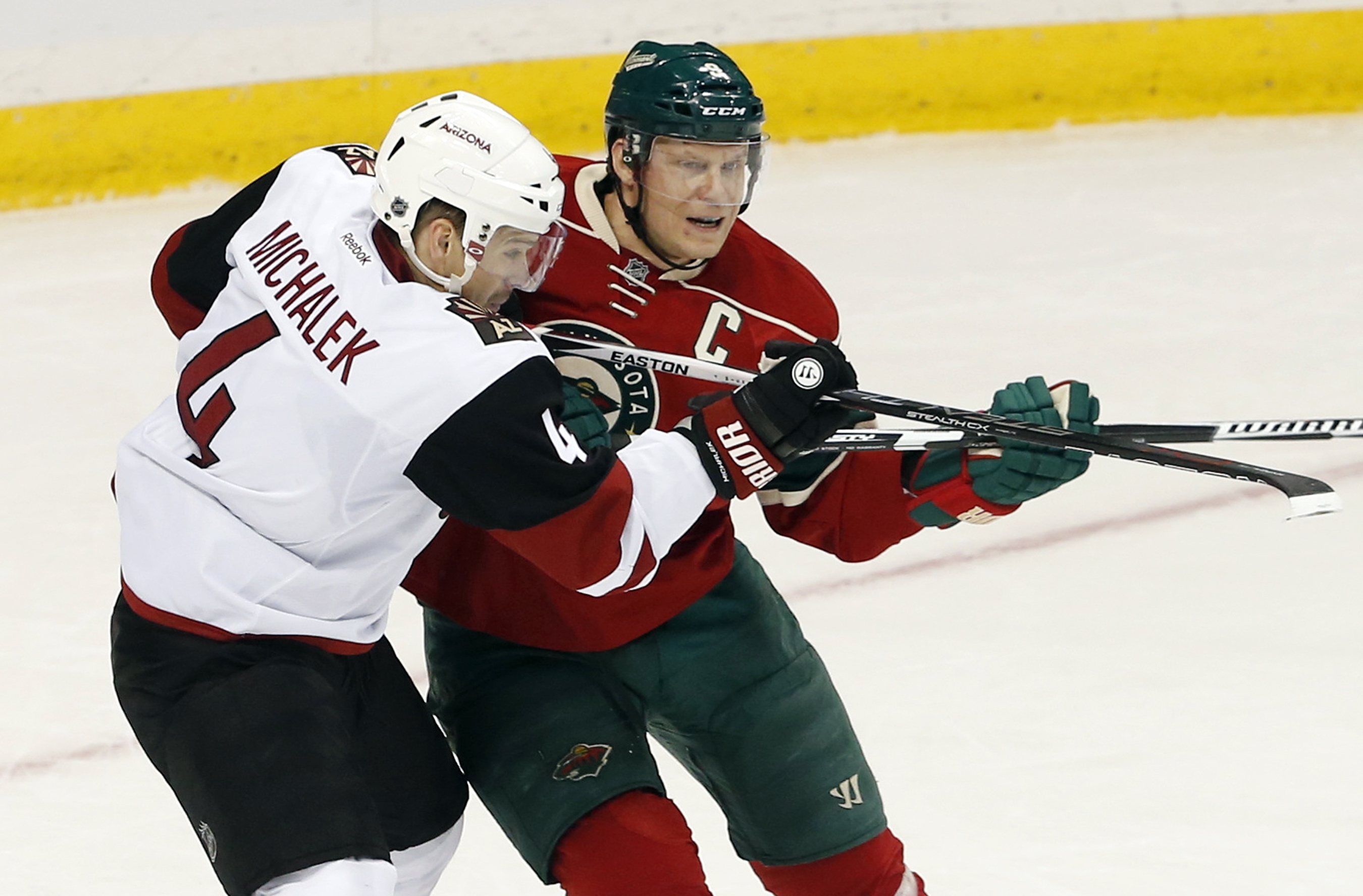 Arizona Coyotes' Zbynek Michalek, left, of Czech Republic, impedes Minnesota Wild's Mikko Koivu, of Finland, in the first period  of an NHL hockey game, Monday, Jan. 25, 2016, in St. Paul, Minn. (AP Photo/Jim Mone)