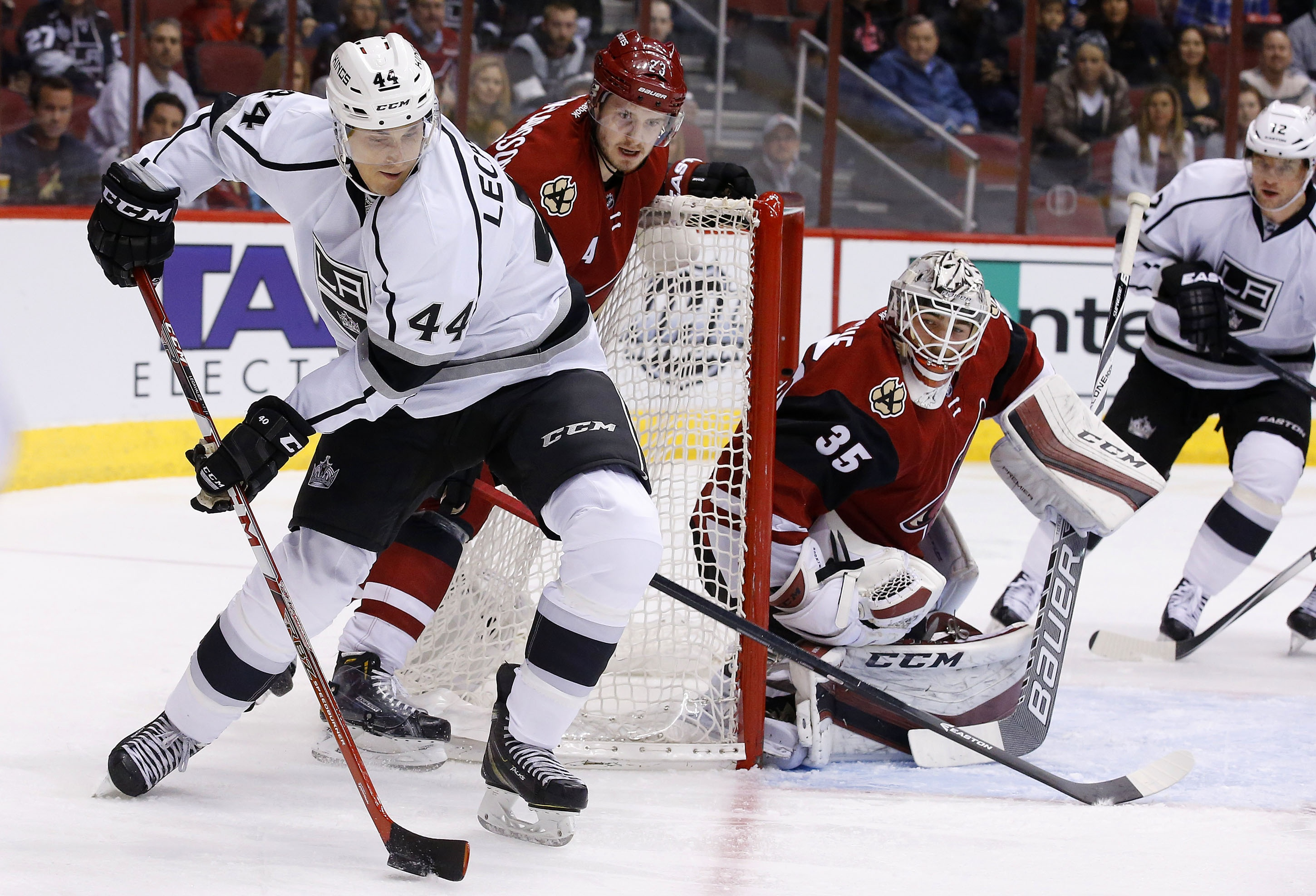 FILE - In this Jan. 23, 2016, file photo, Los Angeles Kings' Vincent Lecavalier (44) moves with the puck as Arizona Coyotes' Oliver Ekman-Larsson (23), of Sweden, defends and Coyotes goalie Louis Domingue (35) and Kings' Marian Gaborik (12), of the Czech