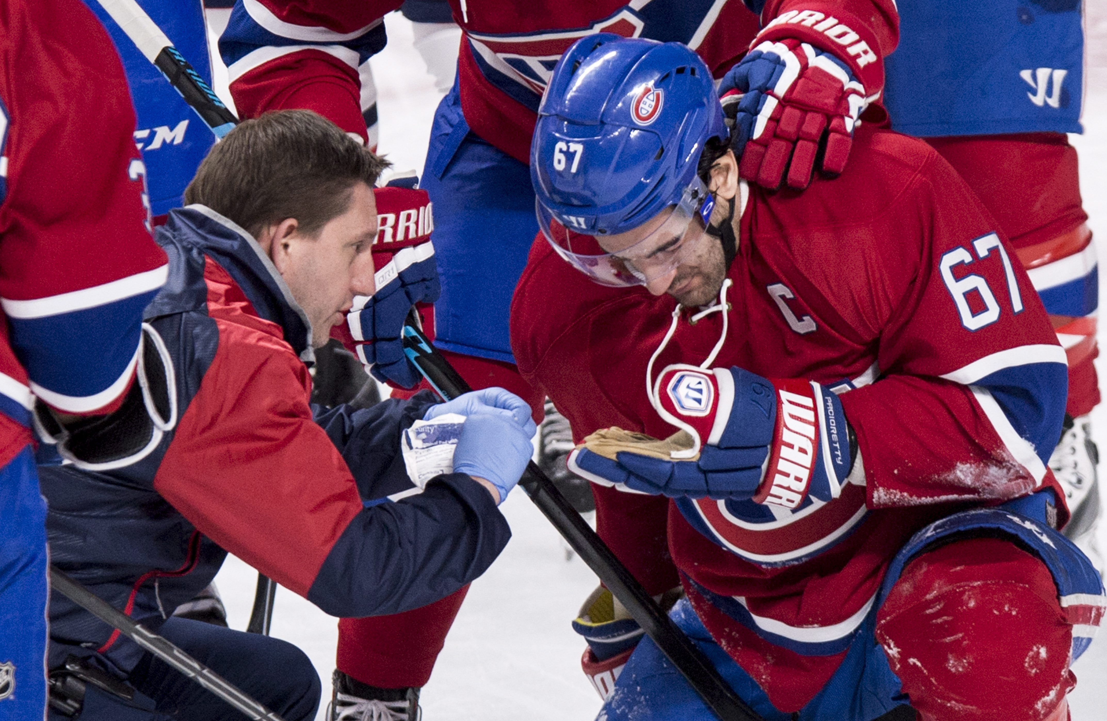 Montreal Canadiens' Max Pacioretty is tended to following an injury during the second period of the team's NHL hockey game against the Columbus Blue Jackets on Tuesday, Jan 26, 2016, in Montreal. (Paul Chiasson/The Canadian Press via AP)