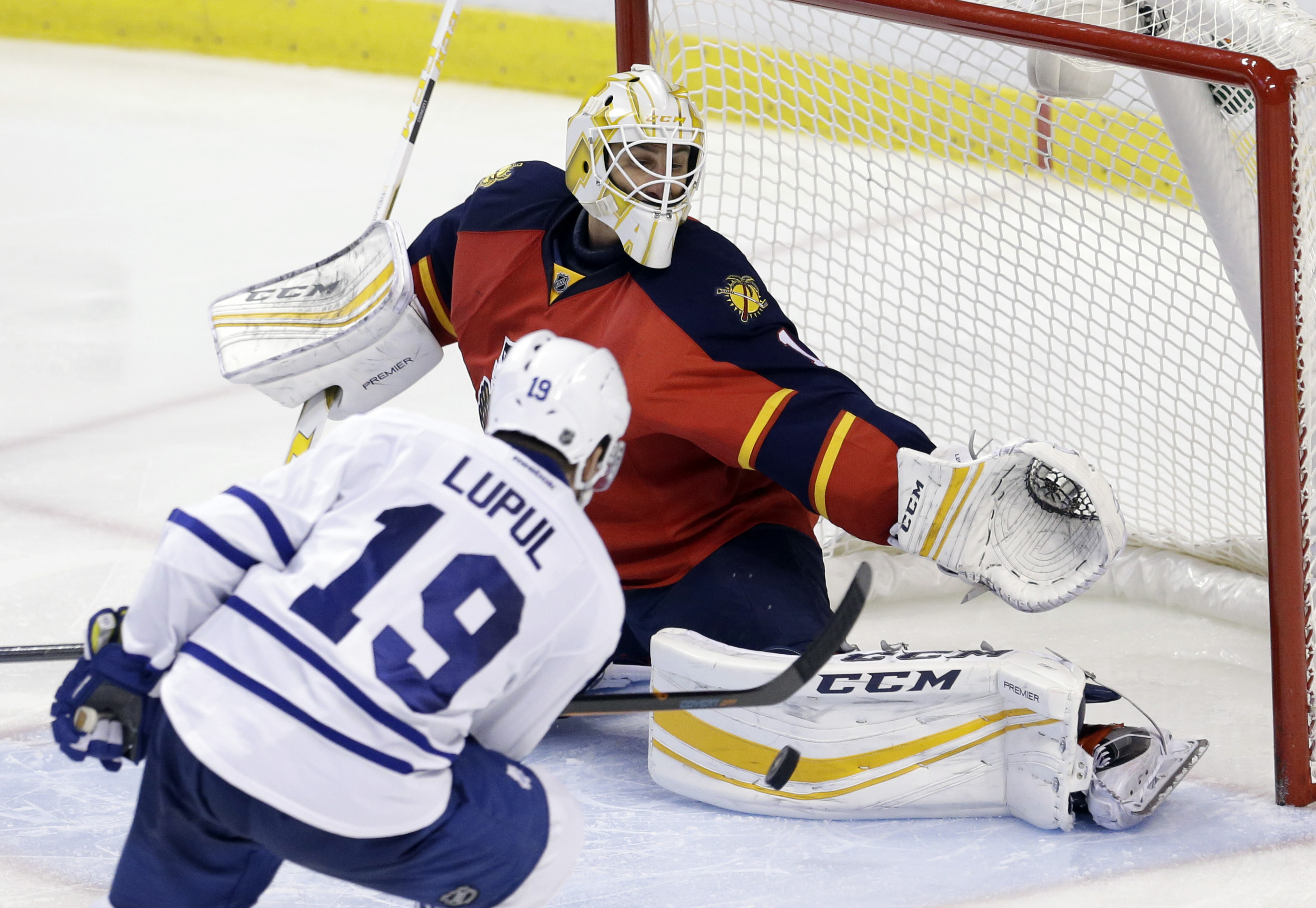 Florida Panthers goalie Roberto Luongo (1) blocks a shot by Toronto Maple Leafs right wing Joffrey Lupul (19) during the third period of an NHL hockey game, Tuesday, Jan. 26, 2016, in Sunrise, Fla. The Panthers won 5-1.  (AP Photo/Alan Diaz)