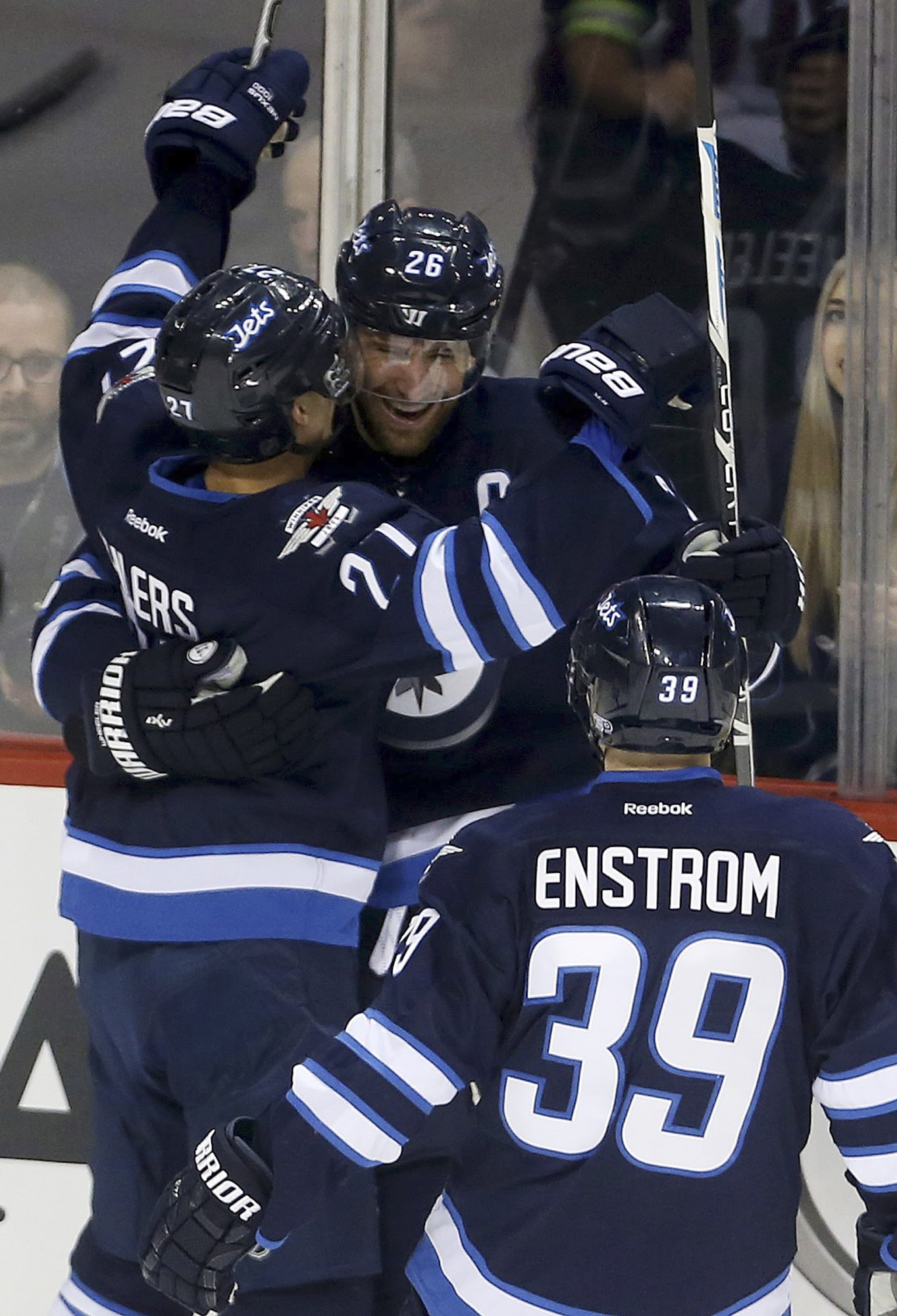 Winnipeg Jets' Nikolaj Ehlers (27), Blake Wheeler (26) and Toby Enstrom (39) celebrate after Ehlers scored his second goal of the period against the Arizona Coyotes in an NHL hockey game Tuesday, Jan 26, 2016, in Winnipeg, Manitoba. (Trevor Hagan/The Cana