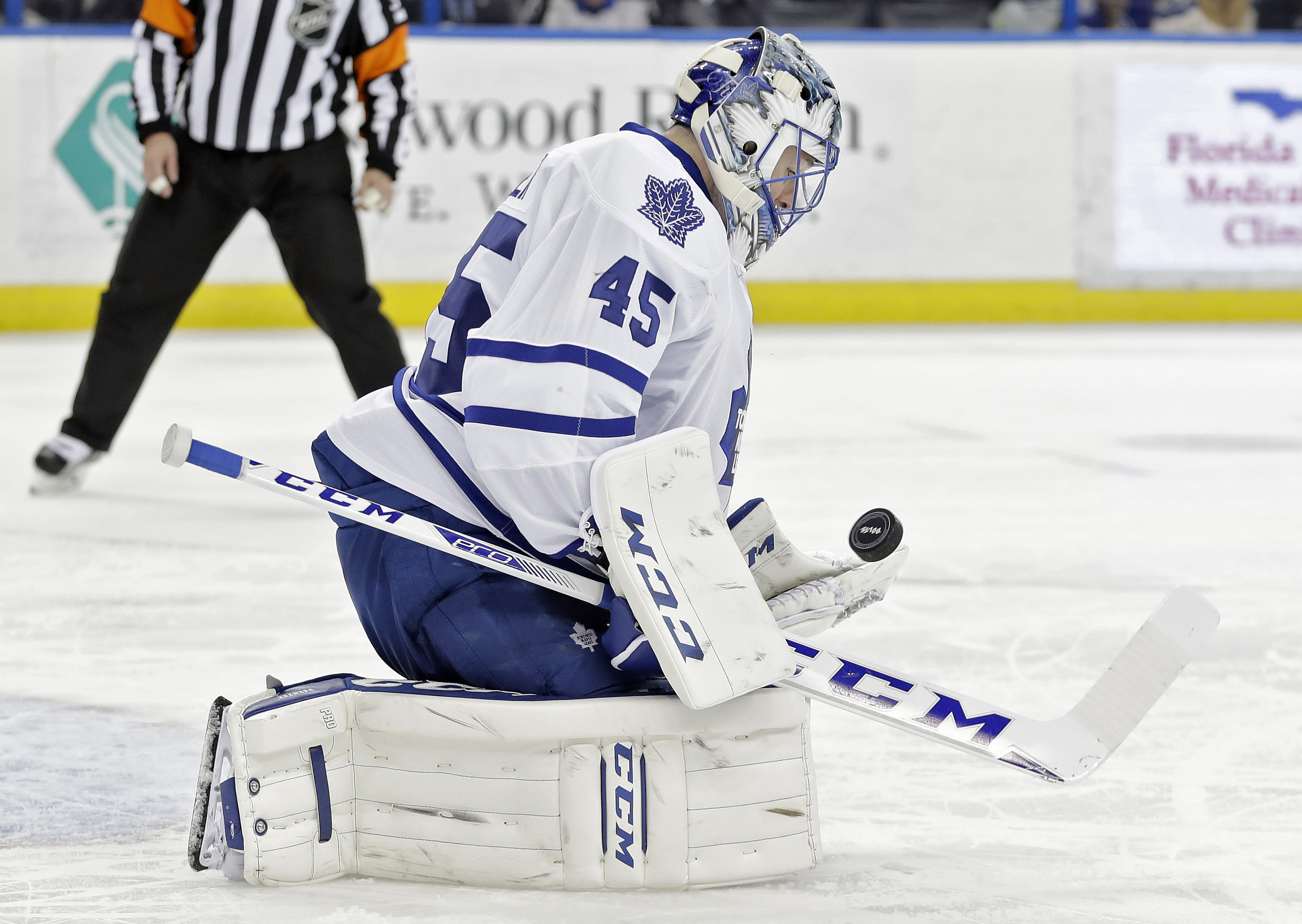 Toronto Maple Leafs goalie Jonathan Bernier (45) makes a save on a shot by the Tampa Bay Lightning during the second period of an NHL hockey game, Wednesday, Jan. 27, 2016, in Tampa, Fla. (AP Photo/Chris O'Meara)