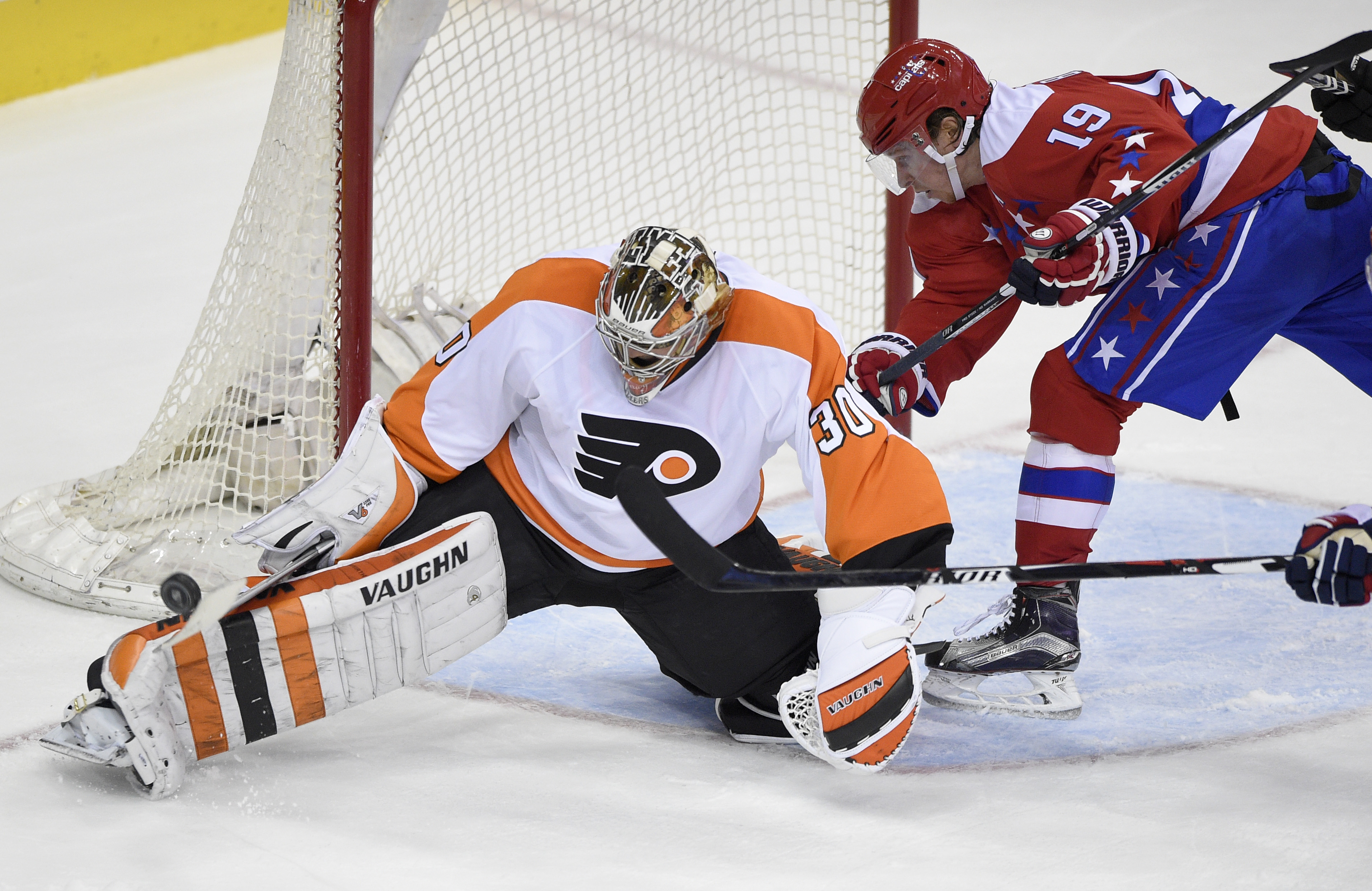 Philadelphia Flyers goalie Michal Neuvirth (30), of the Czech Republic, stops the puck against Washington Capitals center Nicklas Backstrom (19), of Sweden, during the third period of an NHL hockey game, Wednesday, Jan. 27, 2016, in Washington. The Flyers