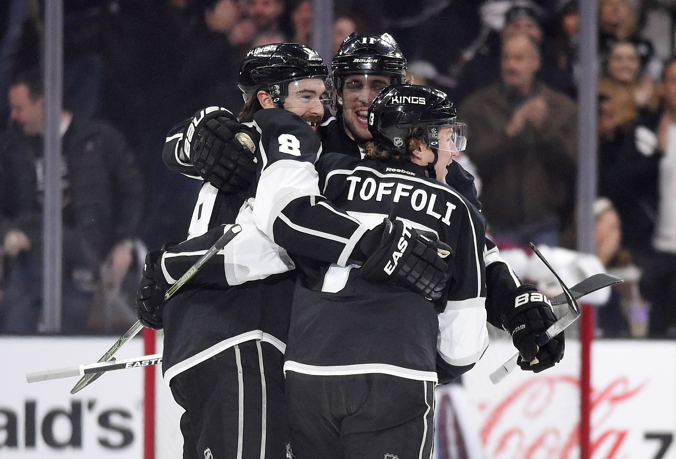 Los Angeles Kings defenseman Drew Doughty, left, celebrates his goal with center Anze Kopitar, center, of Slovenia, and center Tyler Toffoli during the first period of an NHL hockey game against the Colorado Avalanche, Wednesday, Jan. 27, 2016, in Los Ang