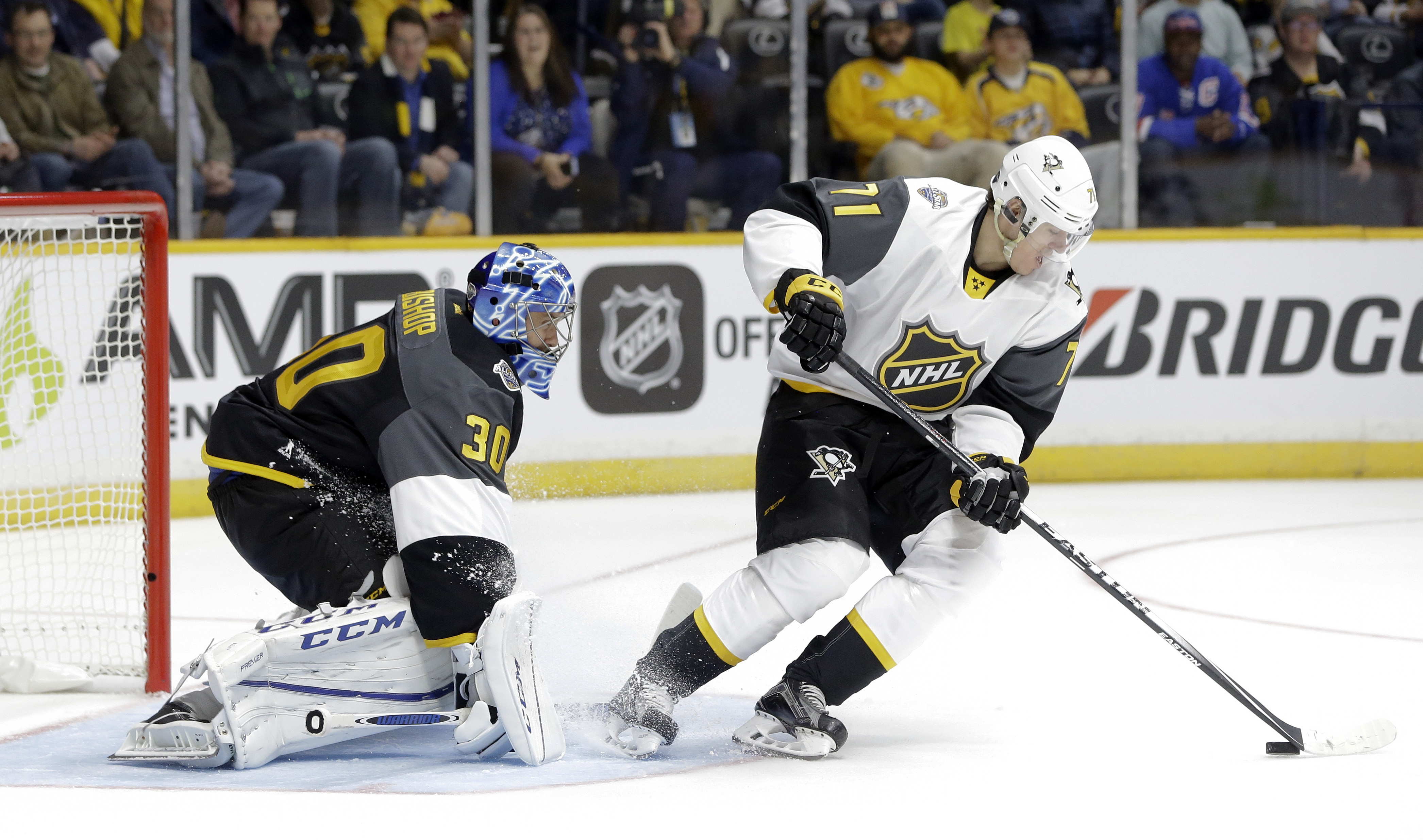 Metropolitan Division forward Evgeni Malkin (71), of the Pittsburgh Penguins, scores a goal against Atlantic Division goalie Ben Bishop (30), of the Tampa Bay Lightning, on a backhanded shot during an NHL hockey All-Star semifinal round game Sunday, Jan.